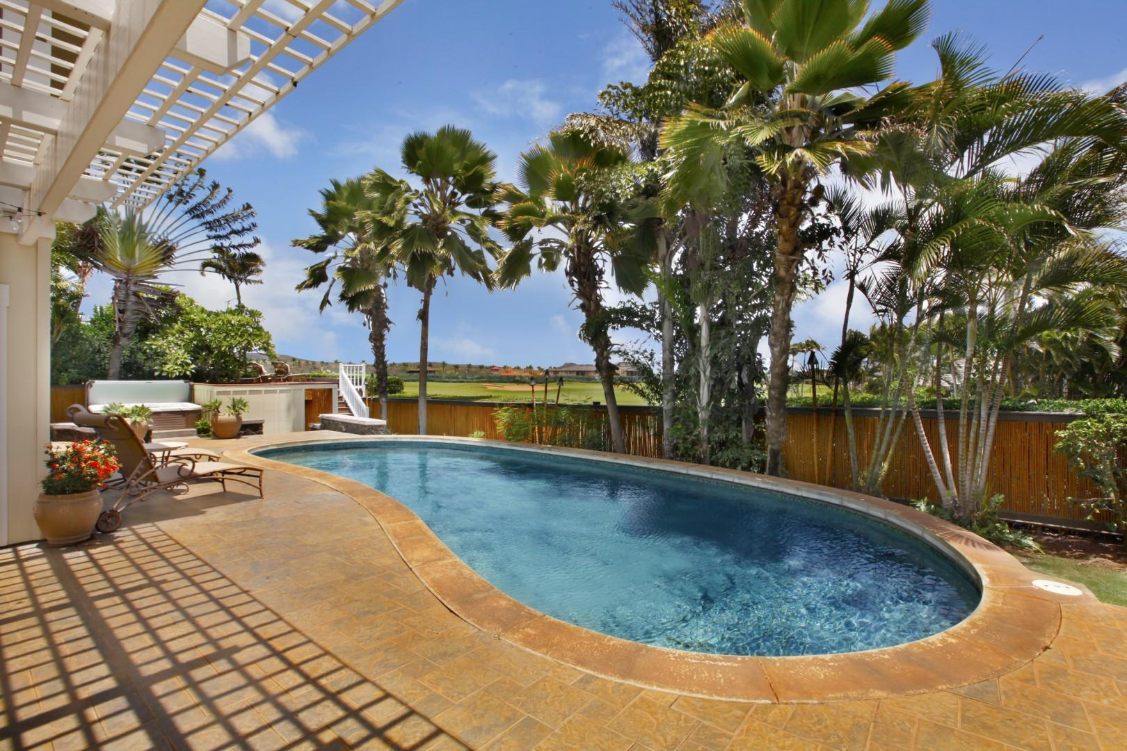 backyard with pool and golf course view