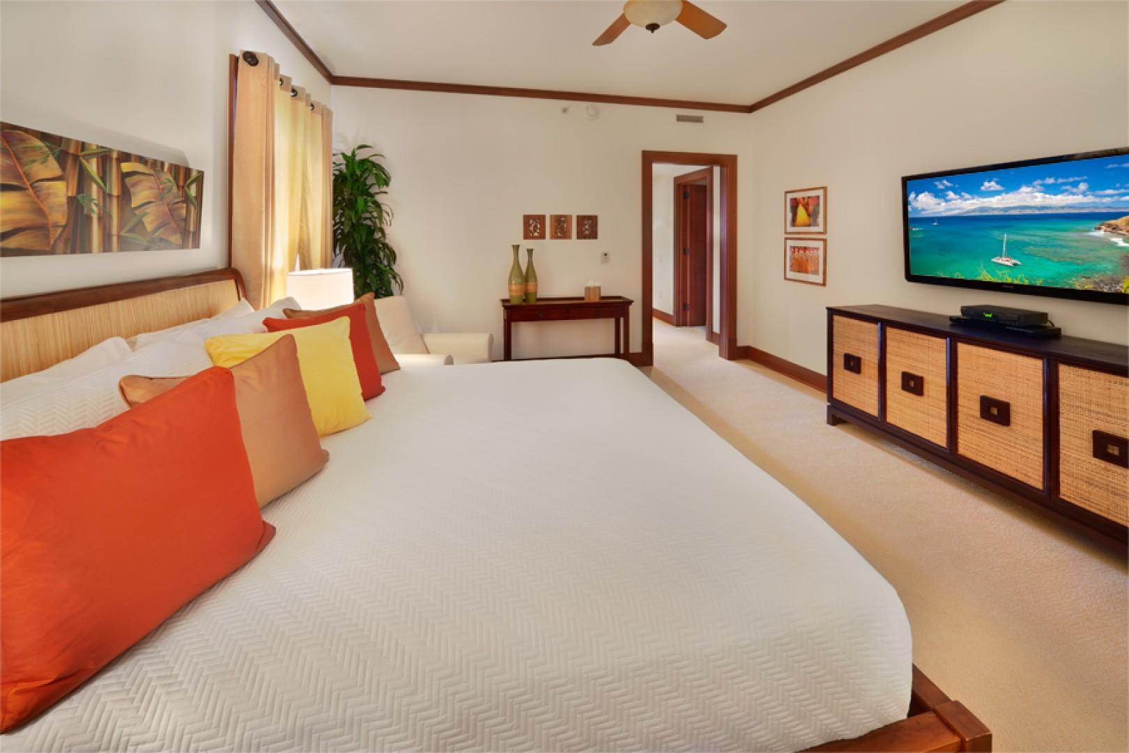 Sea Mist Villa 2403 - Second Master Bedroom with Partial Oceanview, King Bed, Walk-in closet, Large Screen HD TV & HD Cable, HD CD/DVD, iPod dock, Velvet Lined Drapery, Carpet, Reclining Vanilla Leather Reading Chair, Private En-suite Bath