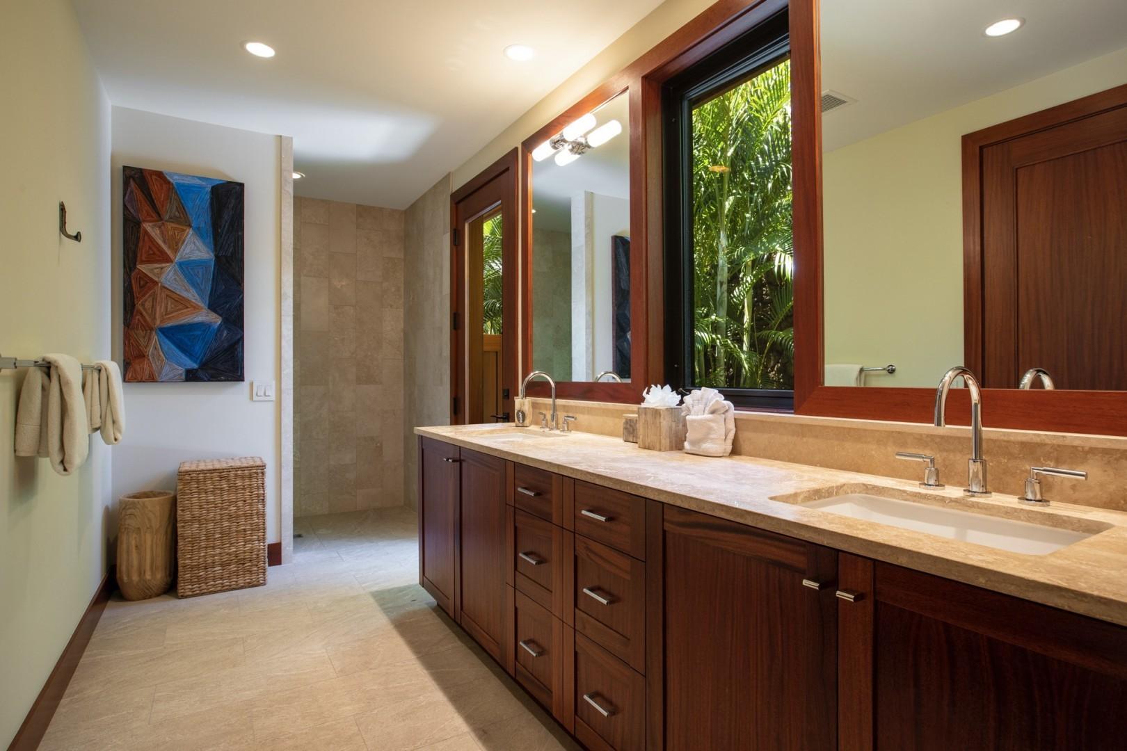 Guest bedroom one en-suite bath with dual vanities, walk-in shower and outdoor shower garden.