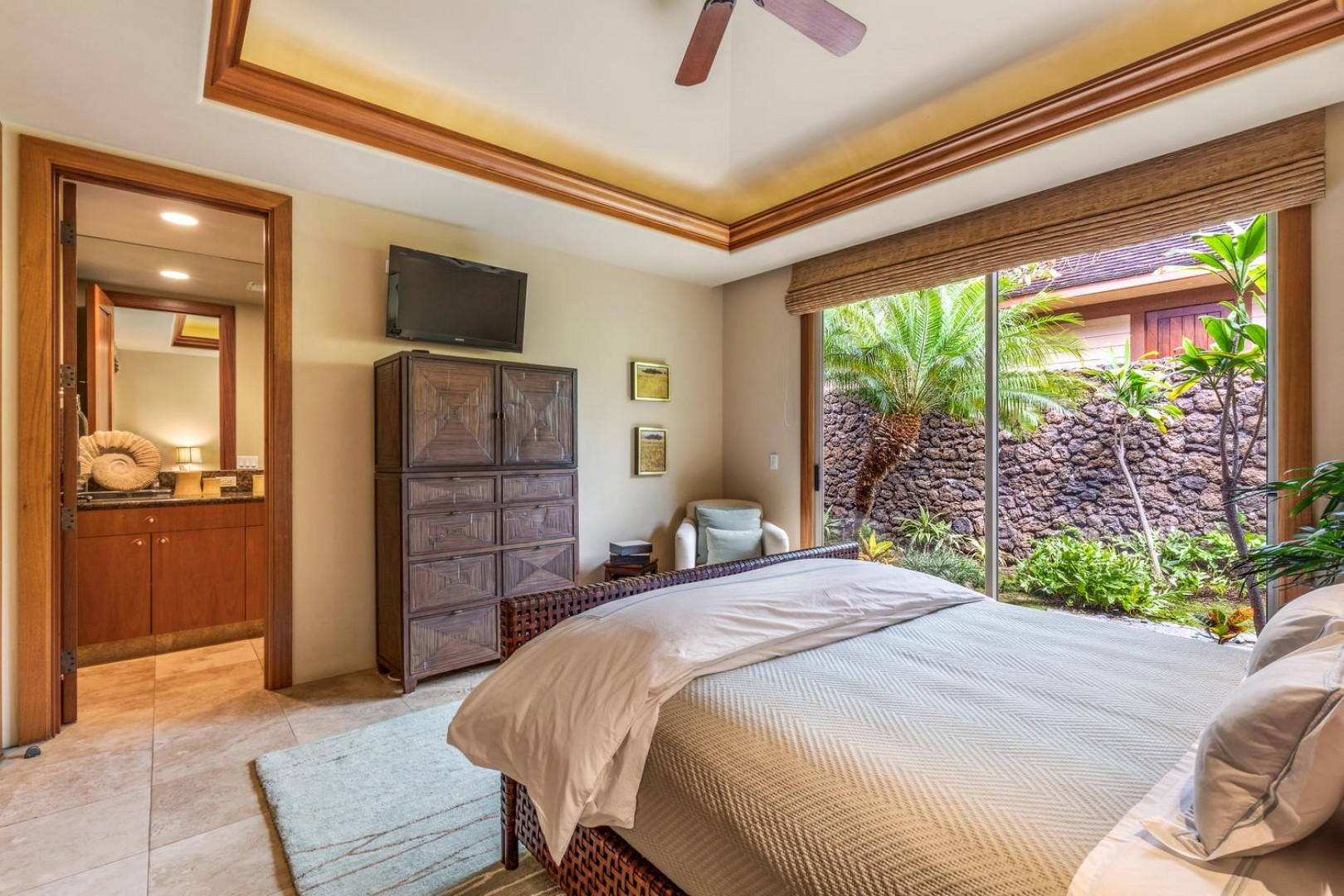 Second guest suite, alternate view showcasing wall-mounted flat screen television.