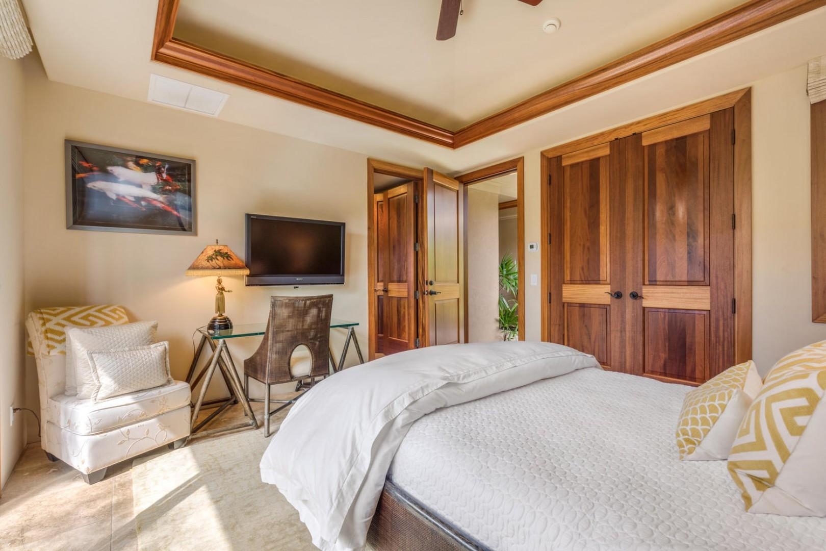 First guest suite, alternate view showcasing wall-mounted flat screen television.