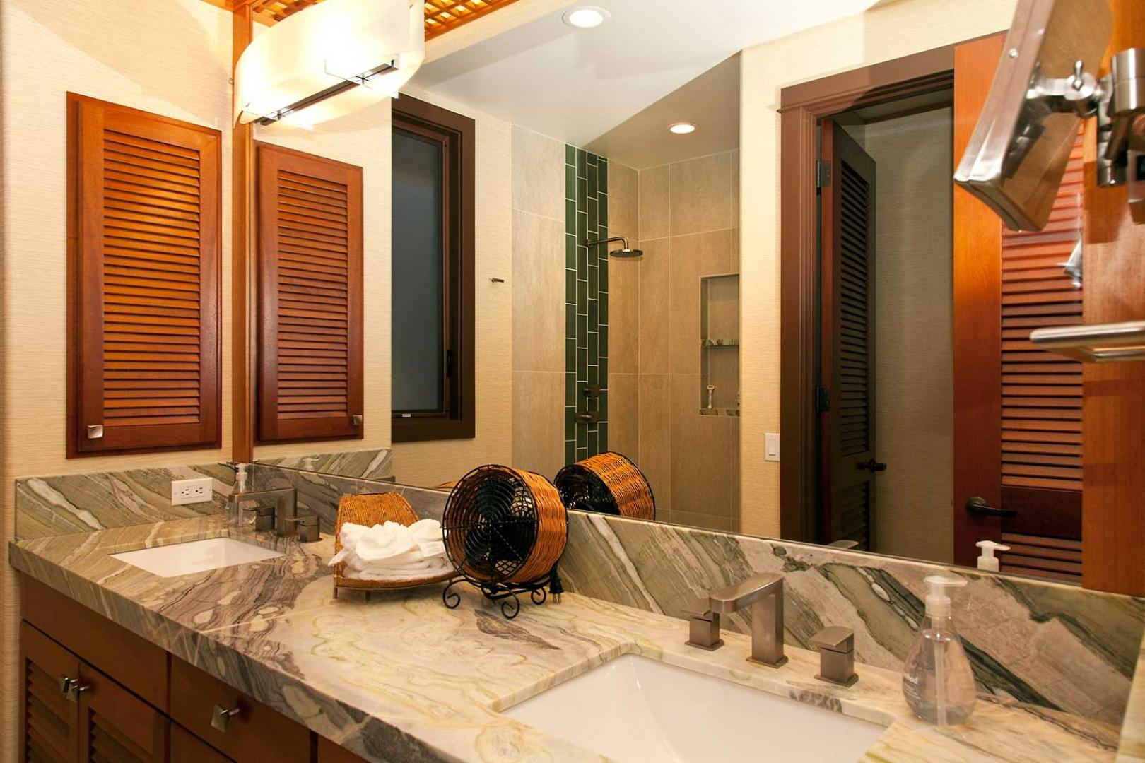Second and third en suite baths share same design: dual sinks, granite counters, walk-in showers, and privacy commodes.