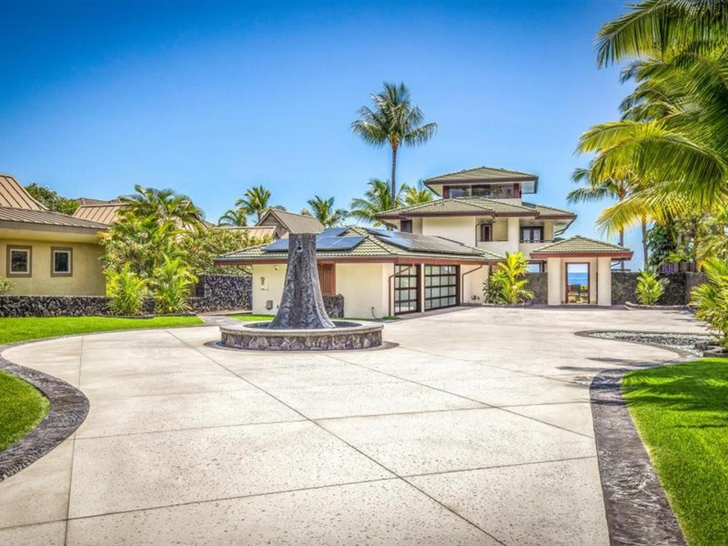 Grand entry to the property with wrap around driveway and water feature
