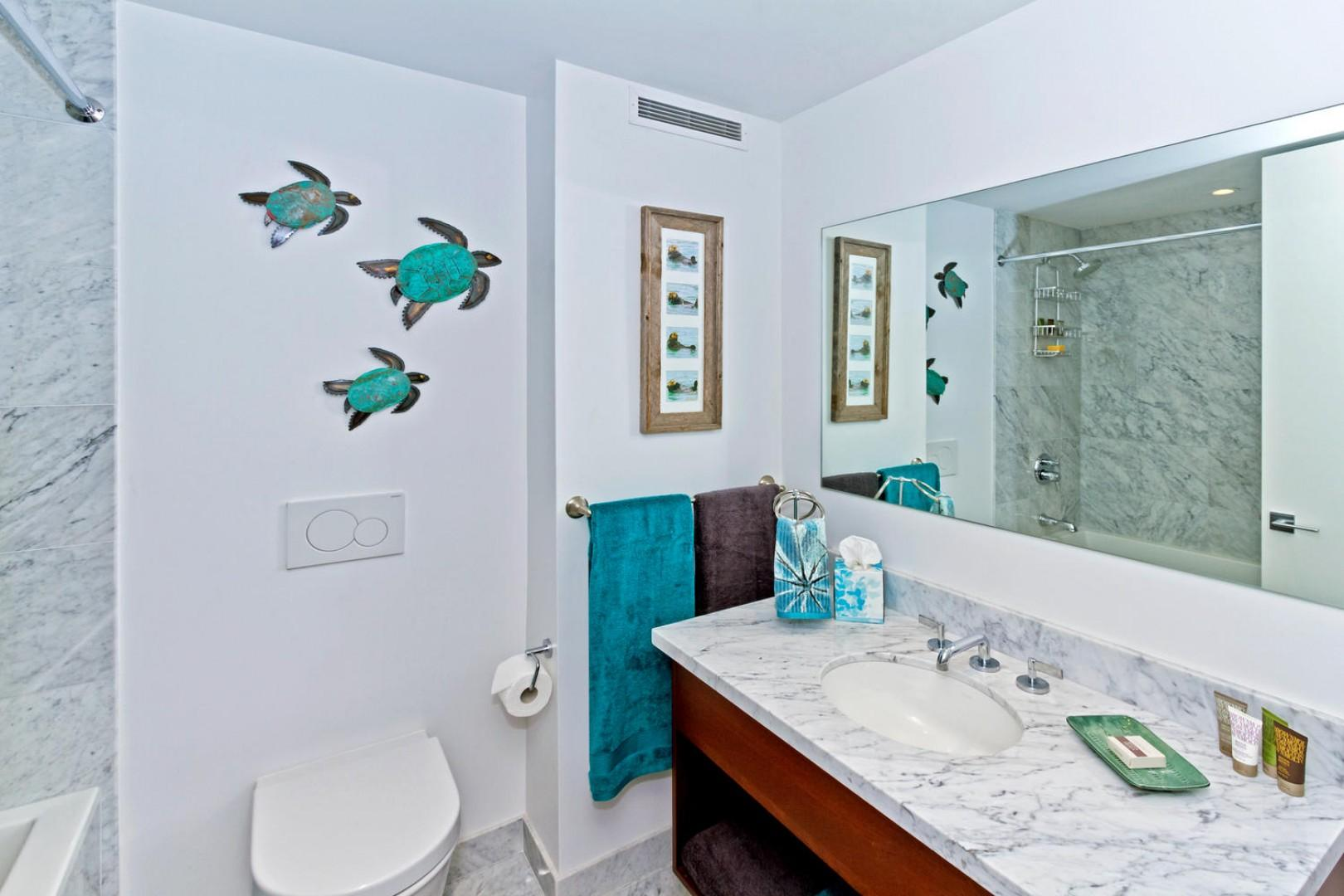 Guest bathroom with bathtub and shower combination.