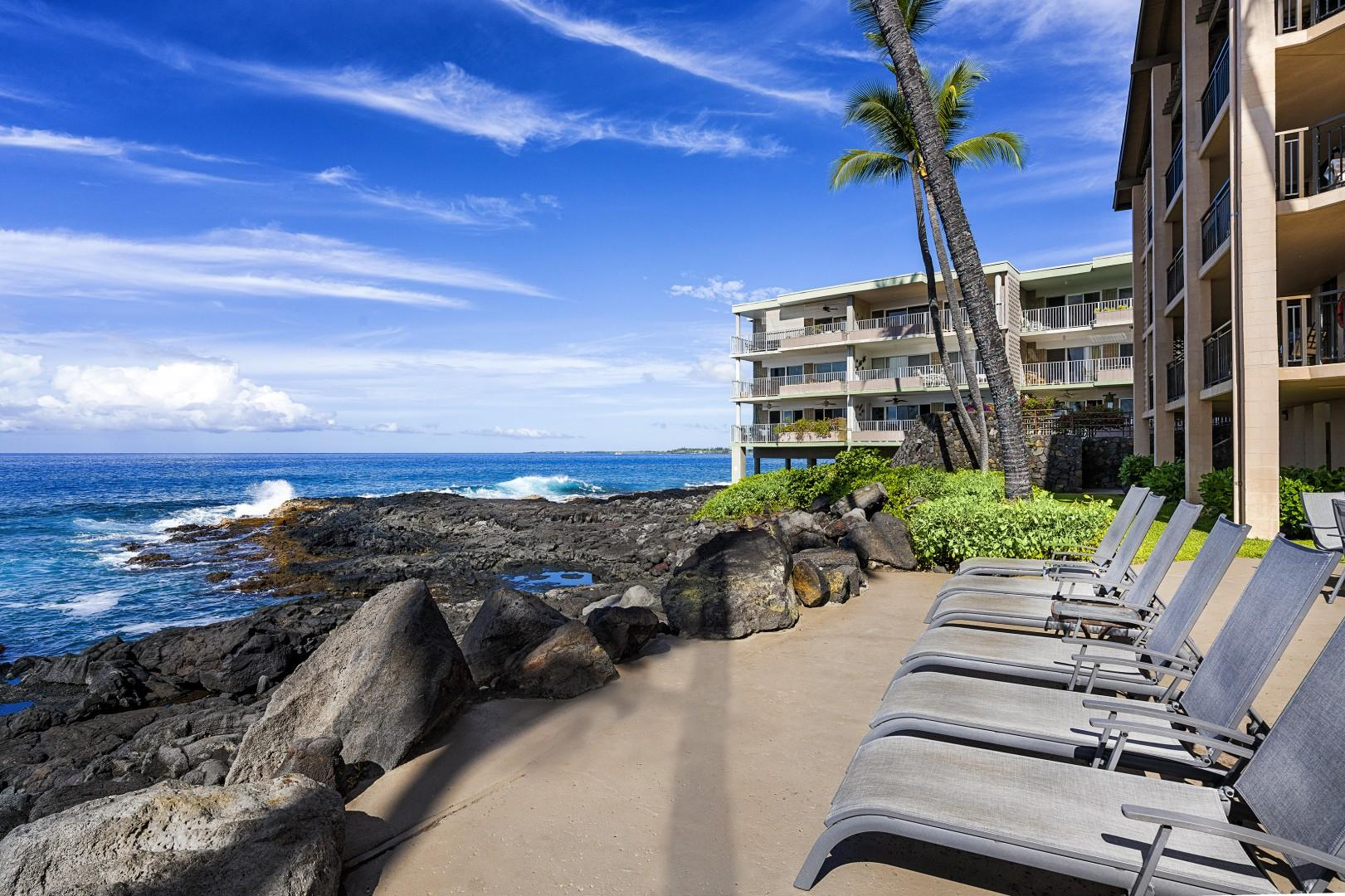 Lounge by ocean at the Kona Makai complex!