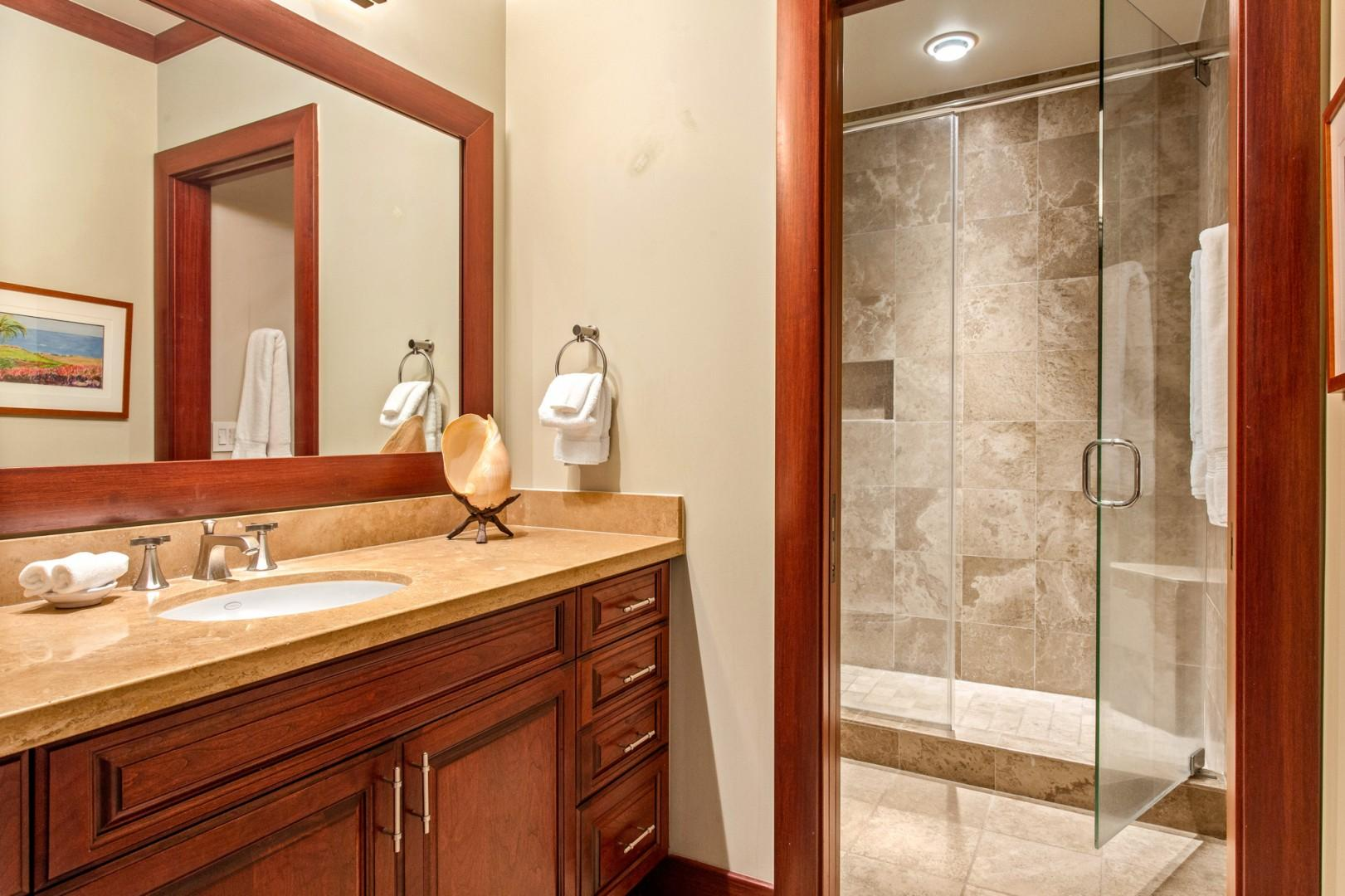 Third bath with glass enclosed shower.