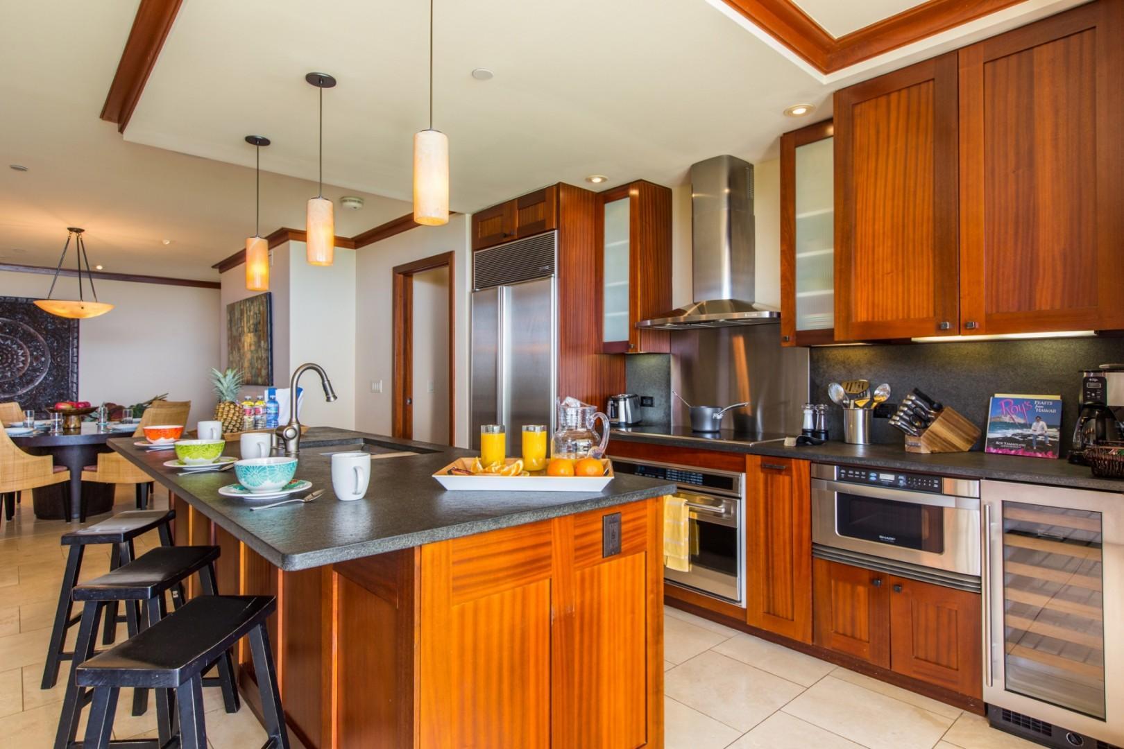 Gourmet kitchen designed by Hawaii chef Roy Yamaguchi; SubZero fridge/freezer, Wolf oven and glass cooktop, Sharp microwave drawer, Fischer & Paykel dishwasher drawers, SubZero wine cooler