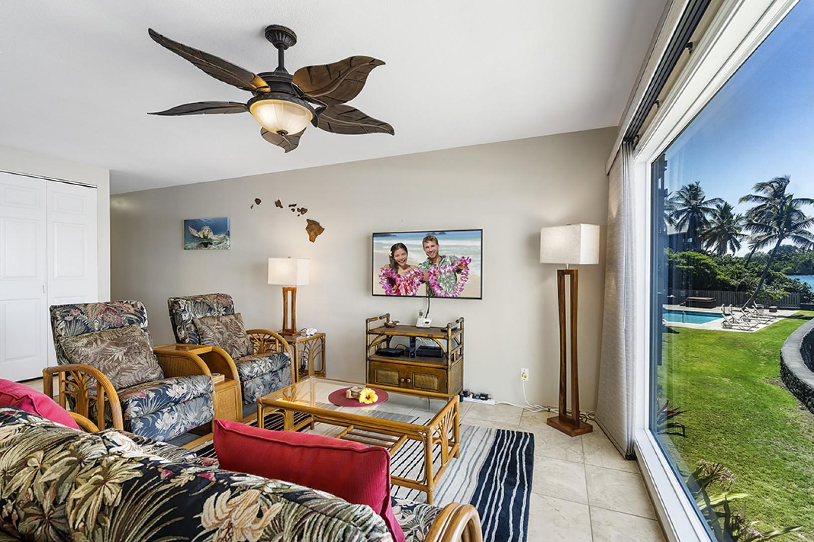 Watch the flat screen TV or watch the surfers in front of the condo!