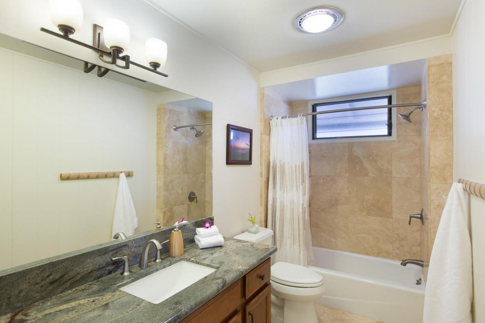 Beautifully remodeled shared bath for bedrooms two and three.