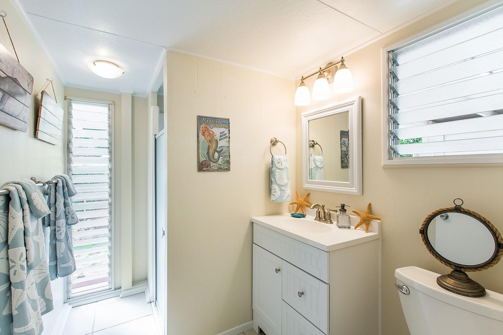 Bathroom off of back living/TV room and laundry room.