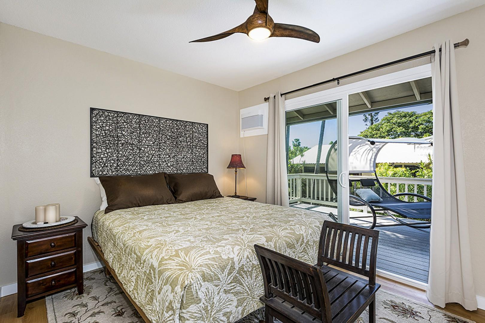 Guest bedroom equipped with Queen bed, lanai access, and A/C
