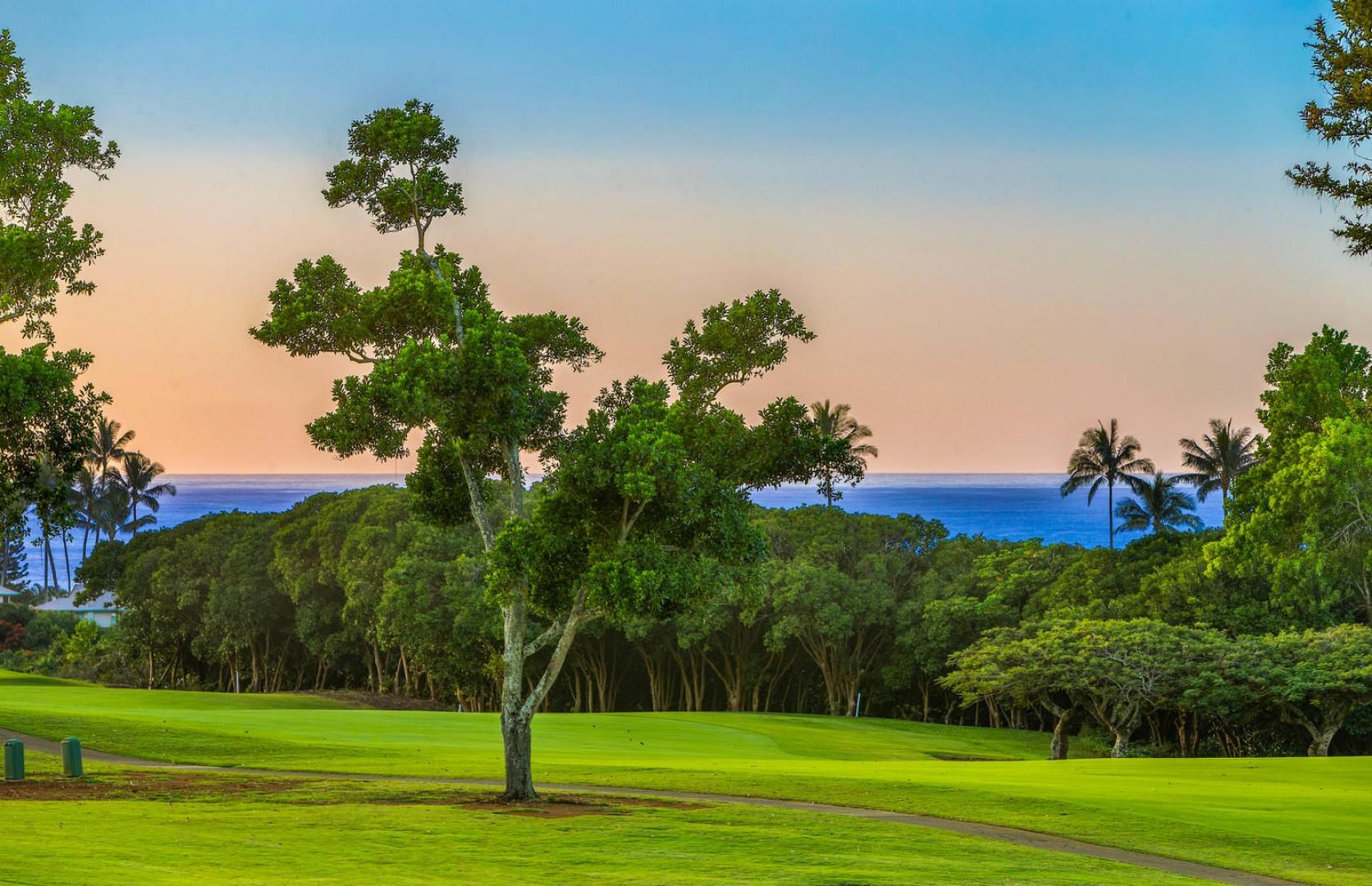 Ocean, golf course and sunset view from the lanai