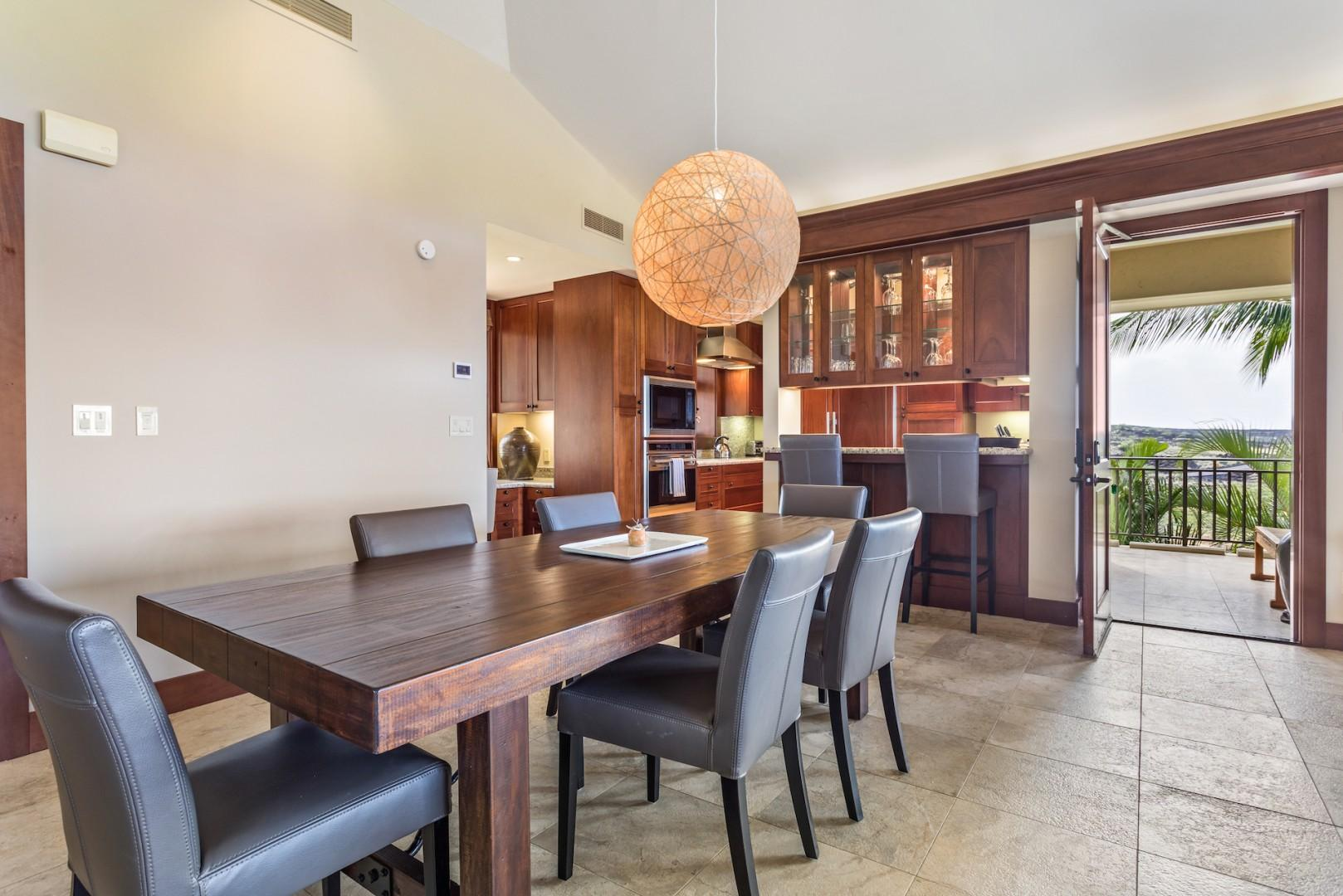 Dining table for 6 with view to the kitchen bar area.