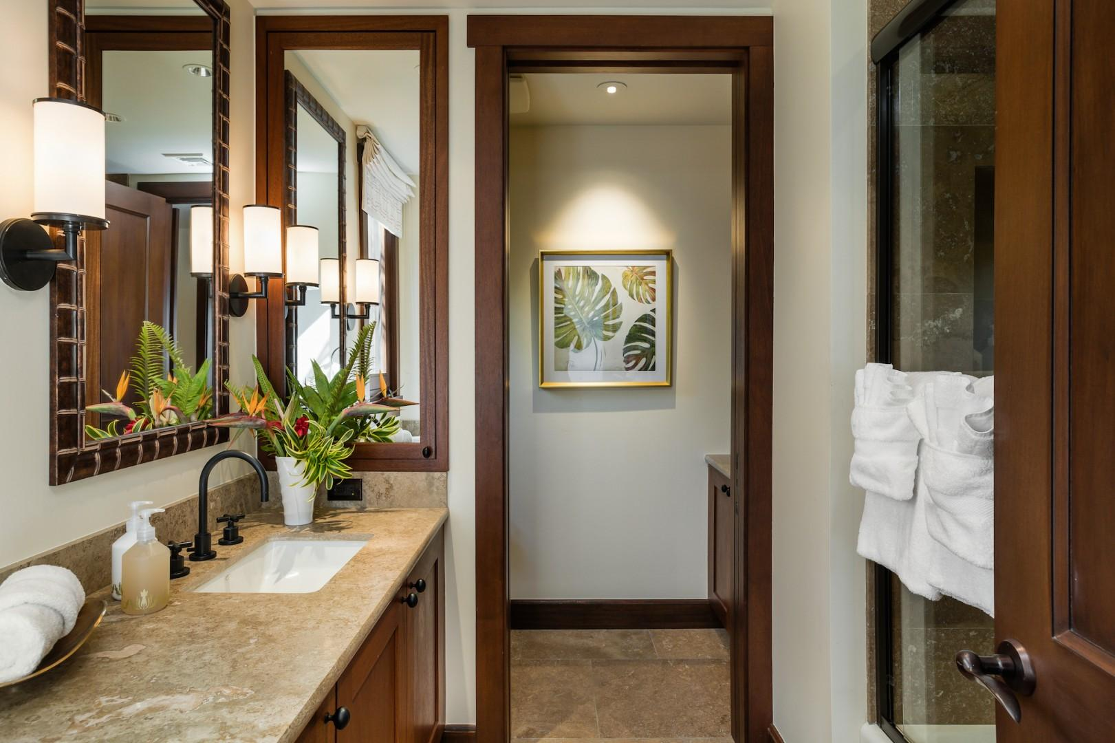 Gorgeous ensuite bathroom for den with granite counter tops and shower with bathtub.