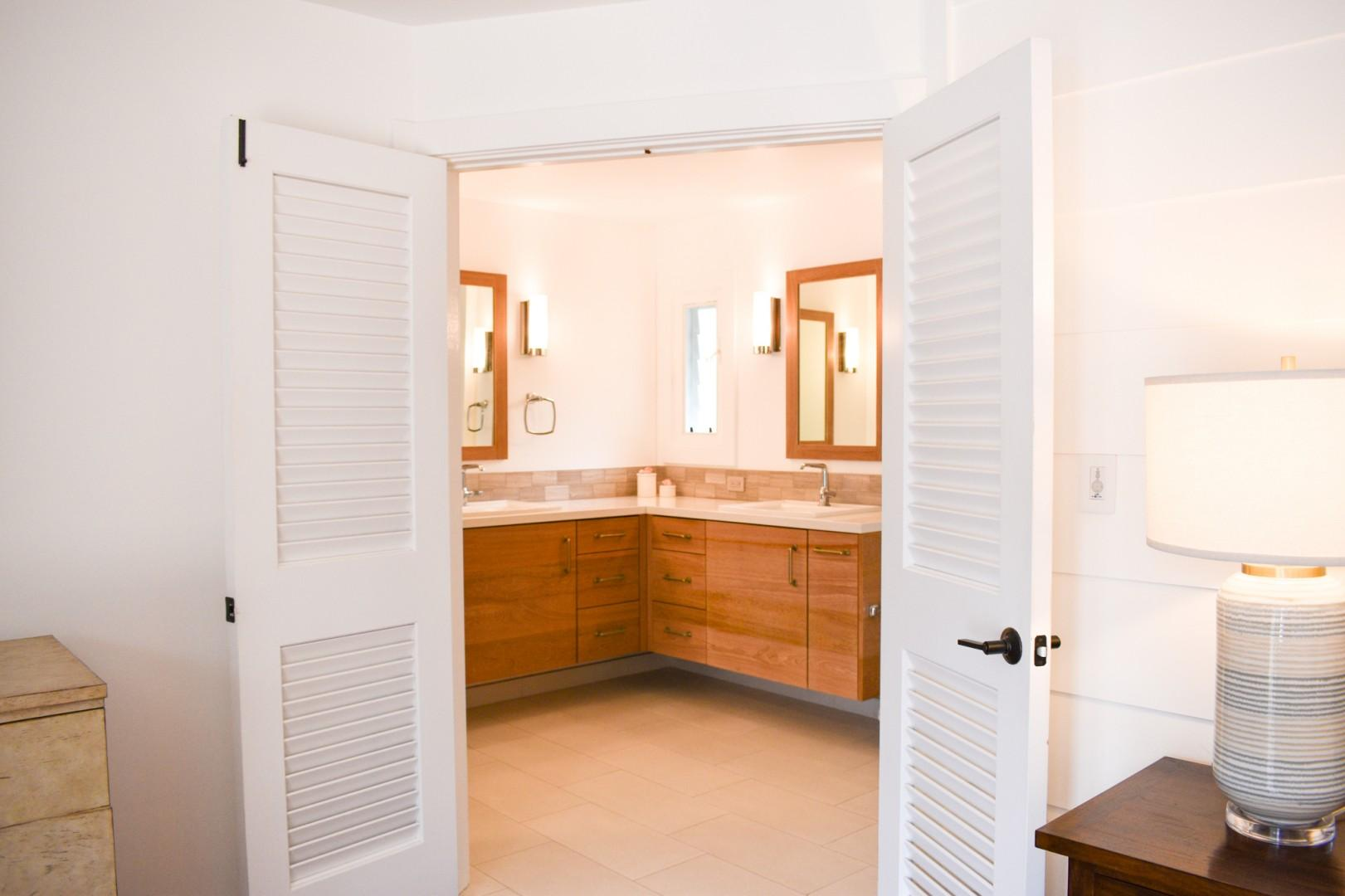 Master bath with double sinks and walk in shower