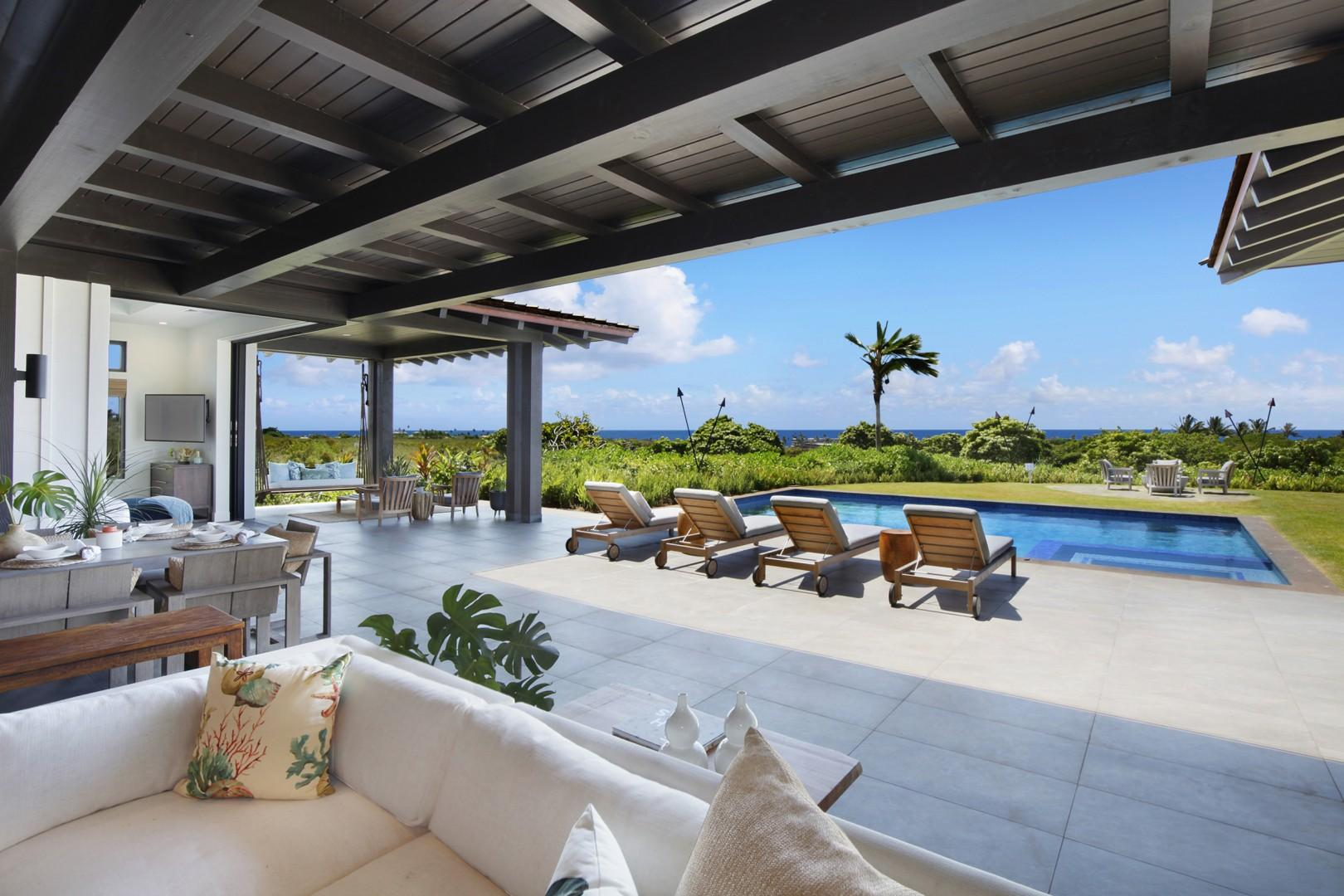 Outdoor living space and pool with ocean views