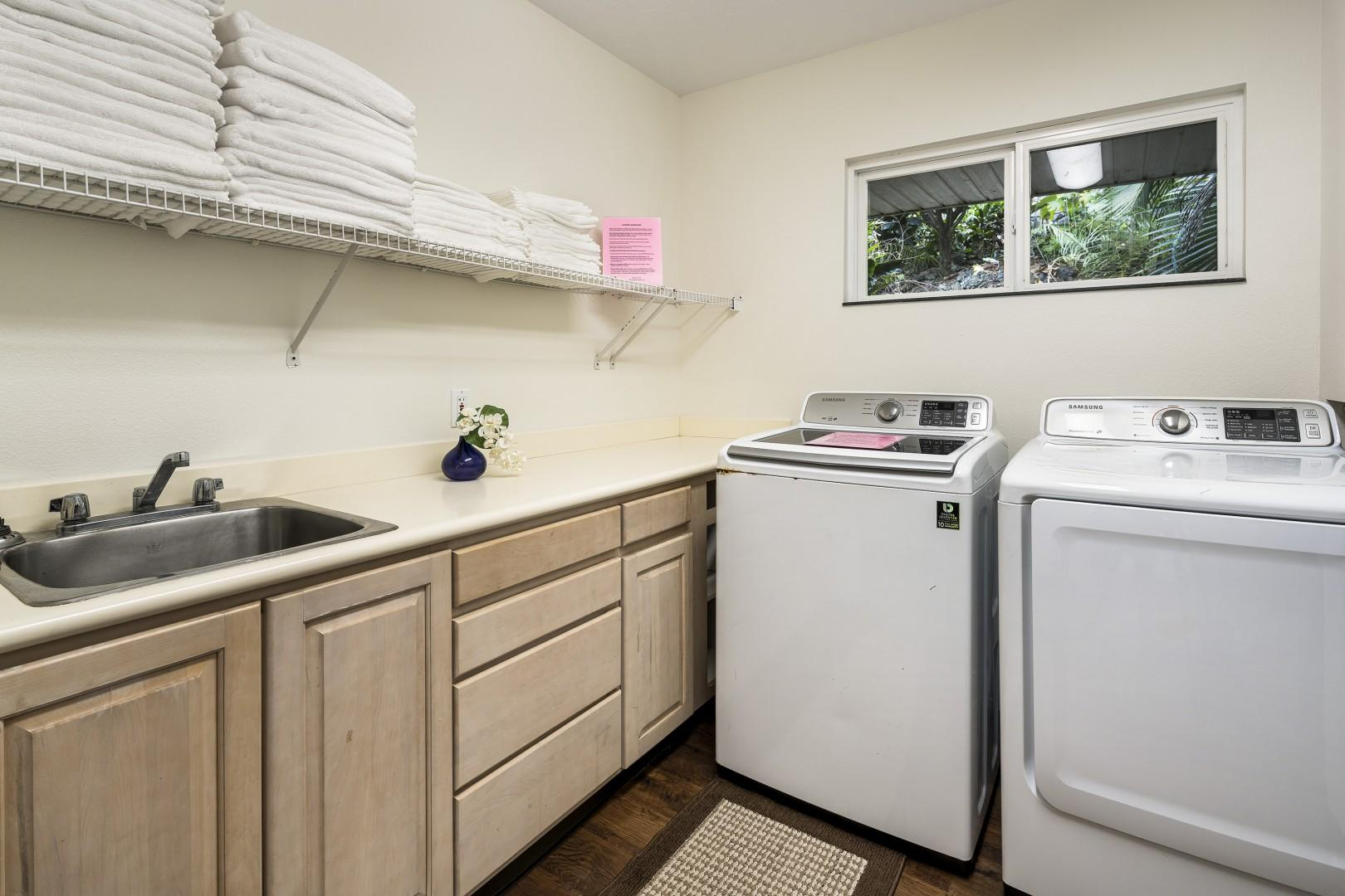 Spacious laundry room with commercial washer / dryer