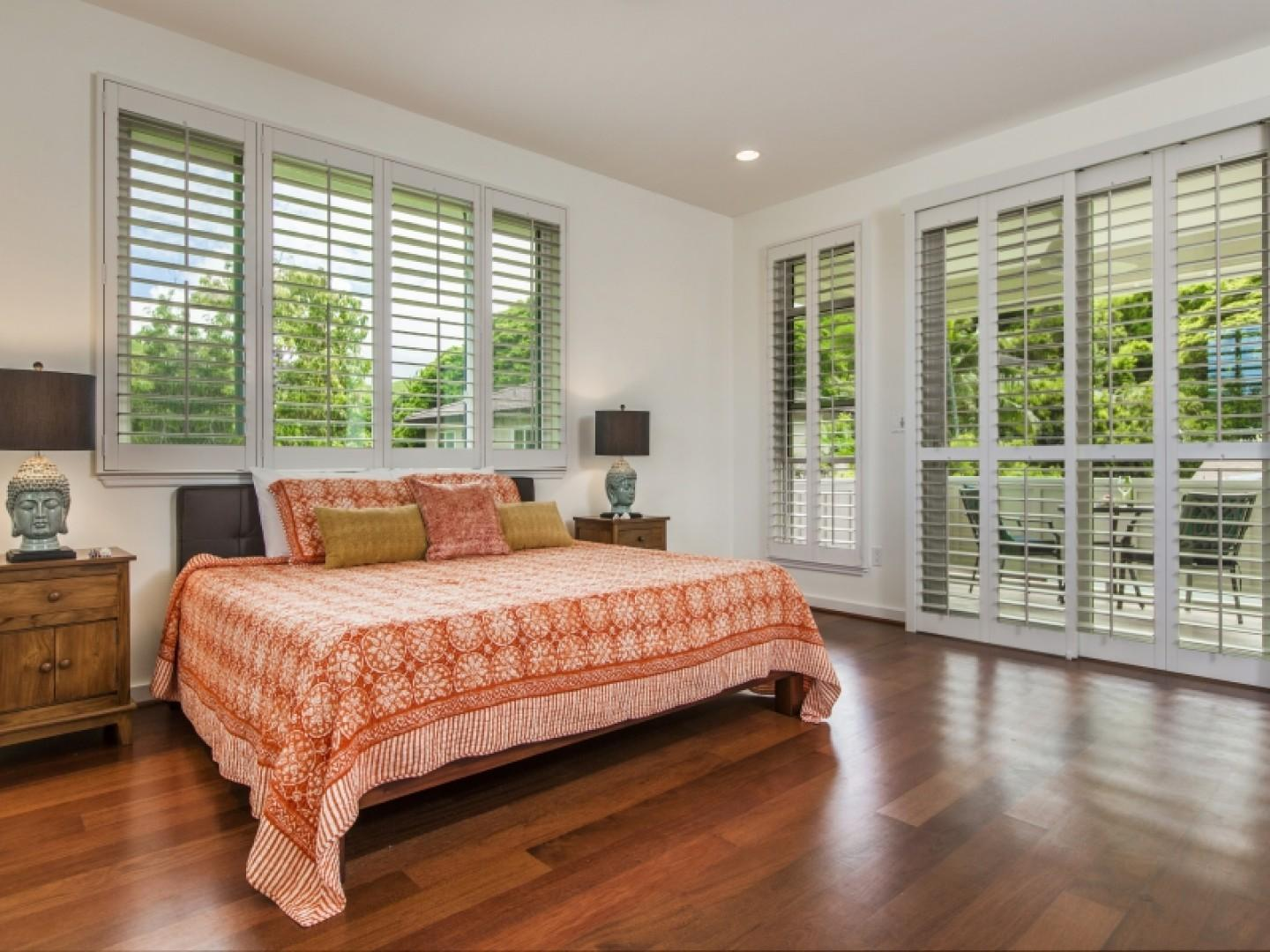 Doors lead to a covered second-floor lanai and offer privacy for the master bedroom.