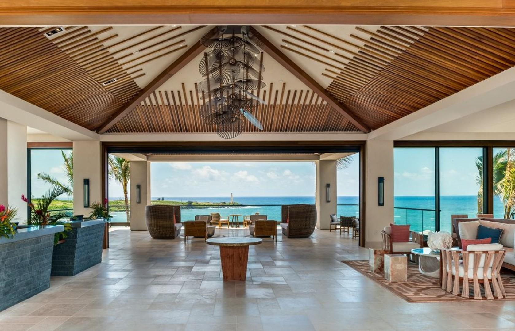 A grand, ocean-view lobby greets you upon arrival.