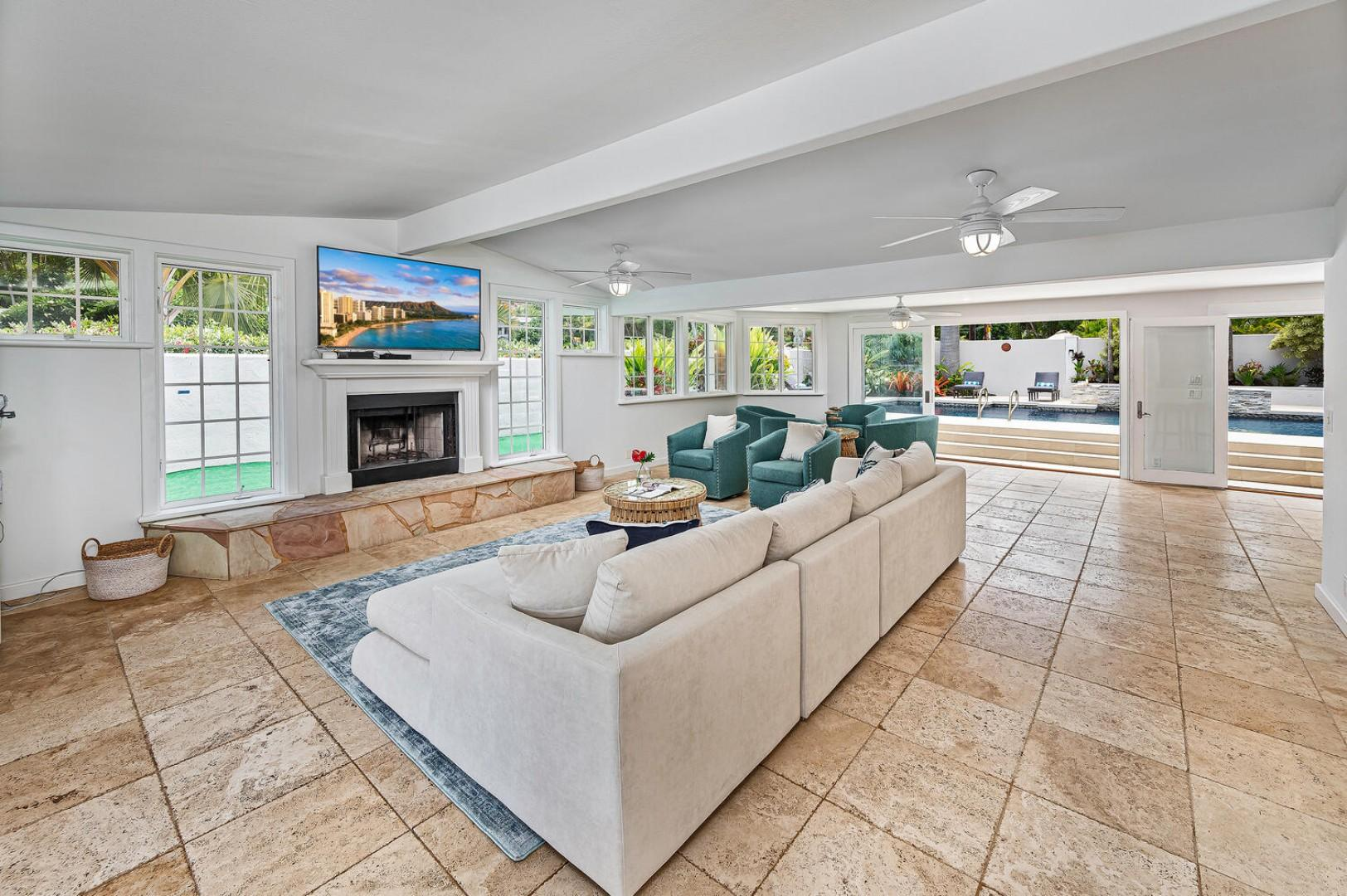 Enjoy the islands cross breeze in the main living-room, complete with a front porch to watch the basketball players in the group!