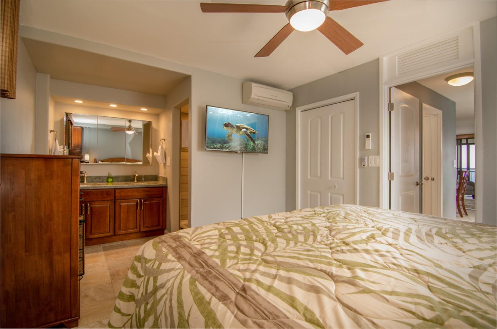 Master bedroom equipped with AC and a large flat screen TV.