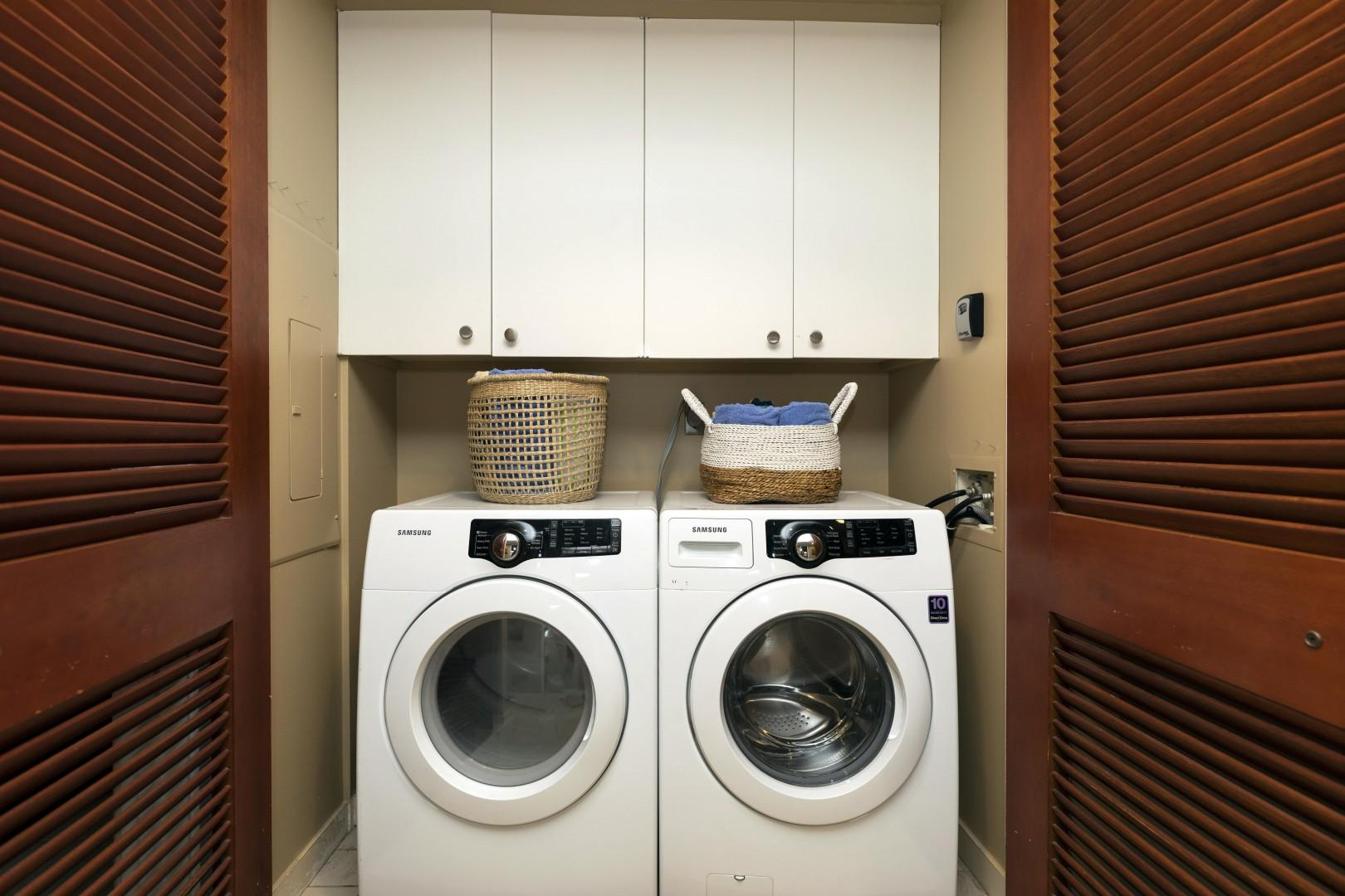 Tucked away are an extra large washer and dryer for your use.