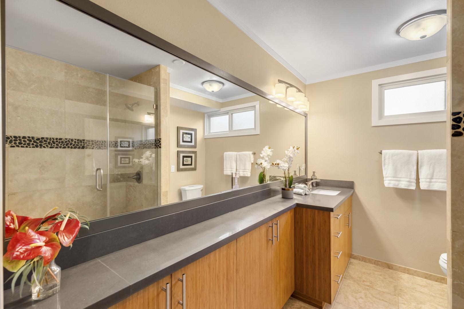 Downstairs bathroom with custom tile shower