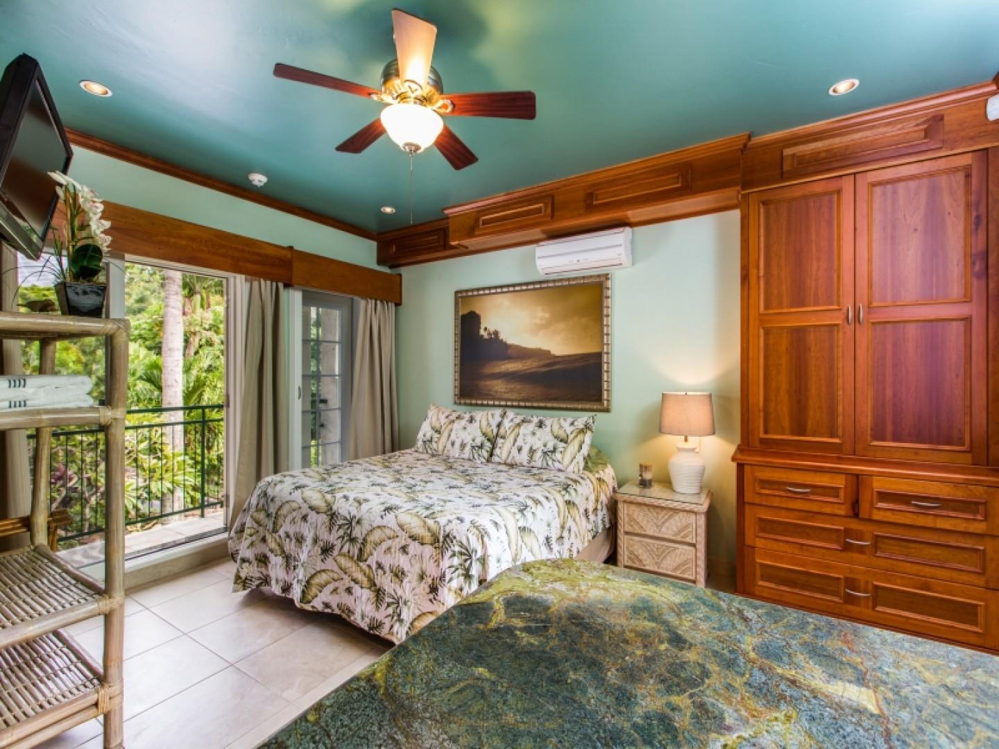Private suite with king-size bed and lanai.