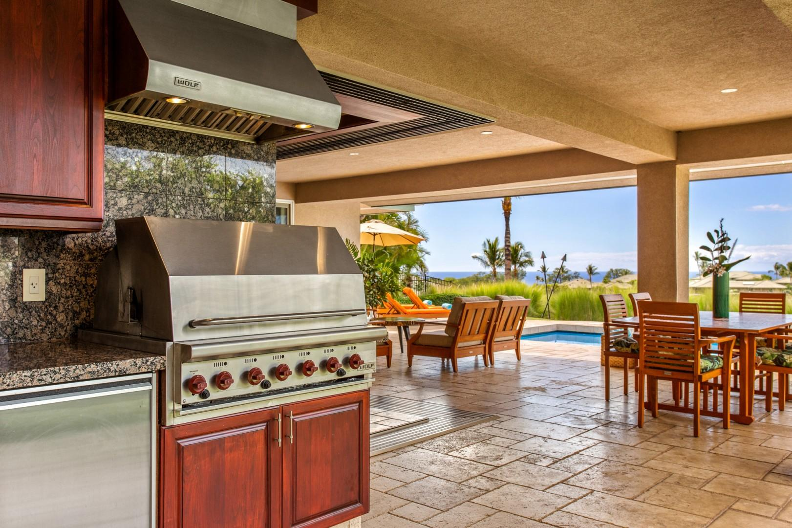 The built-in barbecue grill station with wet bar and mini fridge is perfect for tropical afternoons and evenings.