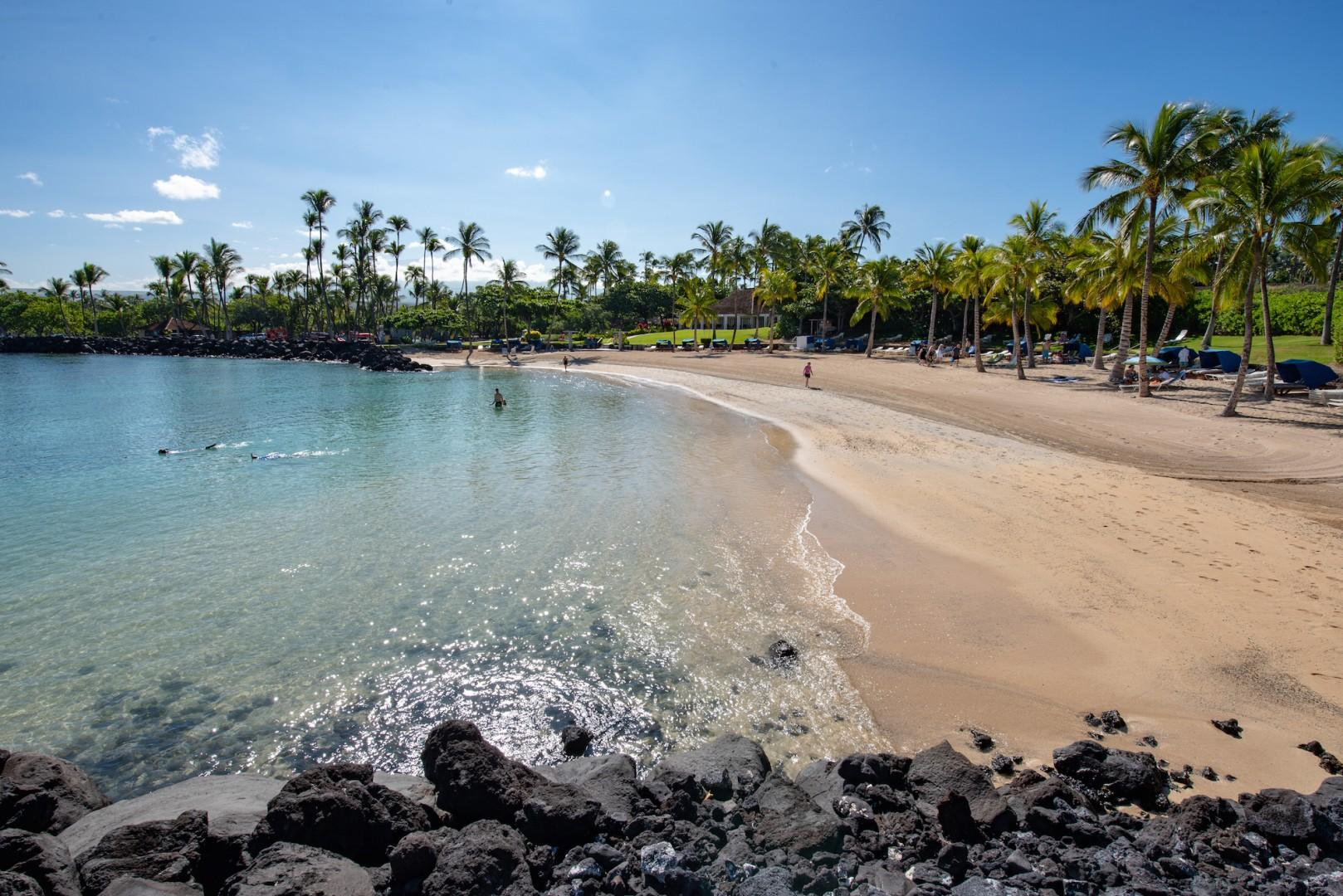 Sparkling Blue Waters Await at the Mauna Lani Beach Club. Guests of a Palm Villas Have Private Access to Beach Club Parking. Napua Open-Air Restaurant Overlooks the Beach.