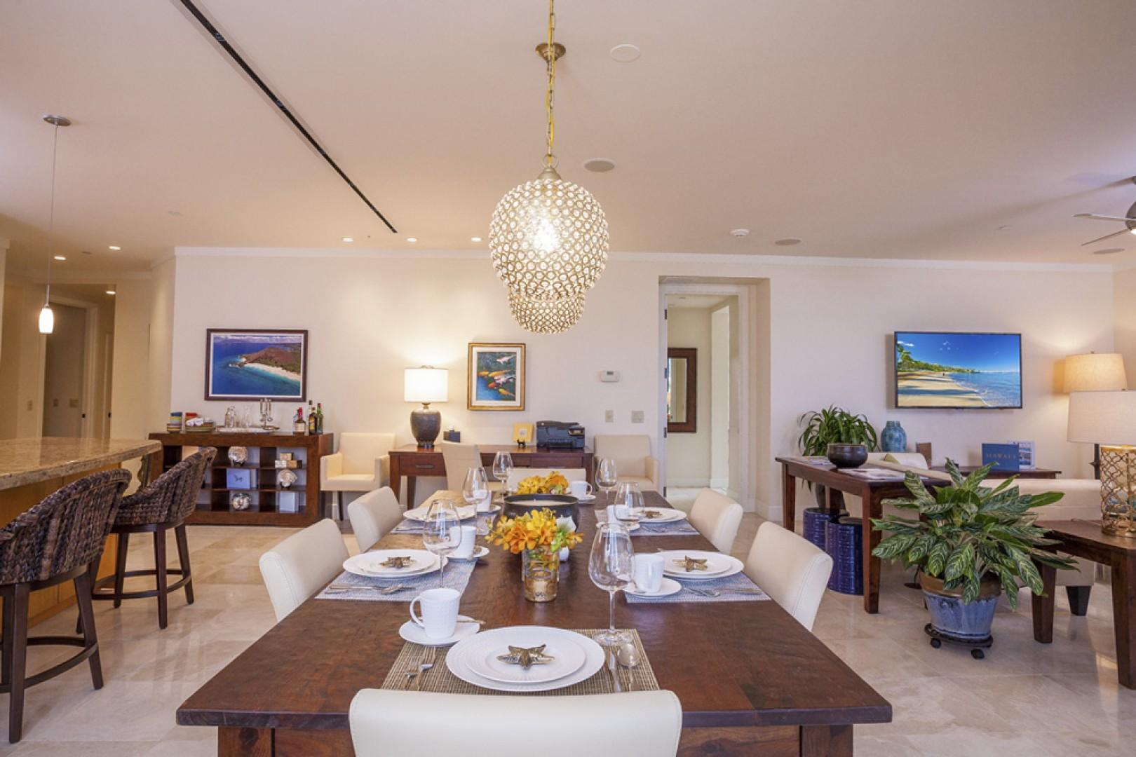 Great room with expansive dining table, large desk, original art, and pull-out full motion Samsung HDTV.