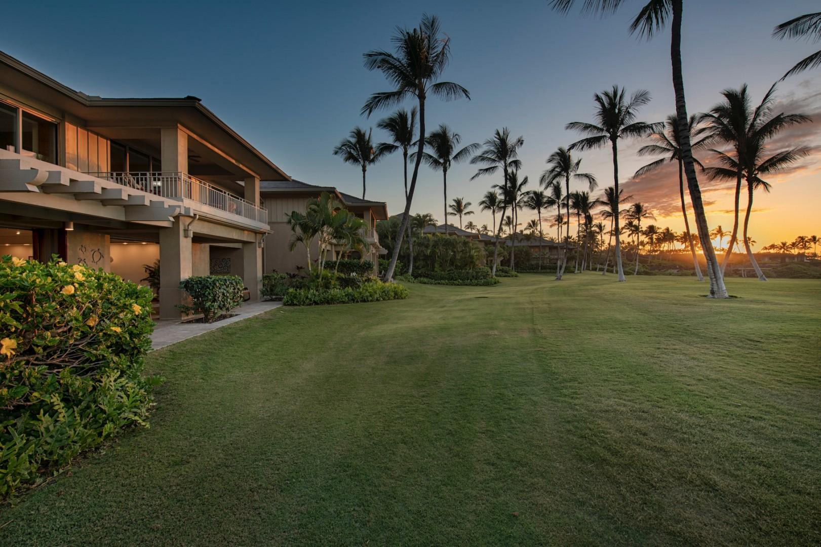 """The famous """"front row"""" of the golf villas at sunset, with nothing but sprawling green between you and the ocean."""