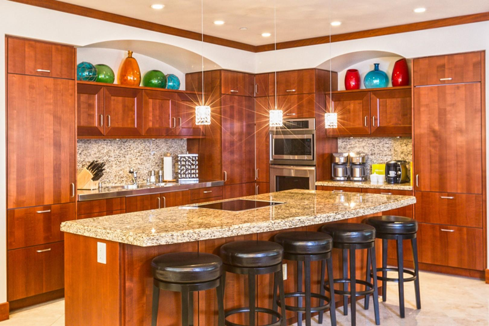 L509 Sandcastles Suite Spacious Gourmet Kitchen with Five Bar Stools and an Indoor Dining Table Seating Eight Guests, Also an Espresso Maker and Two Thermal Coffee-Makers, Abundant Cooking Supplies
