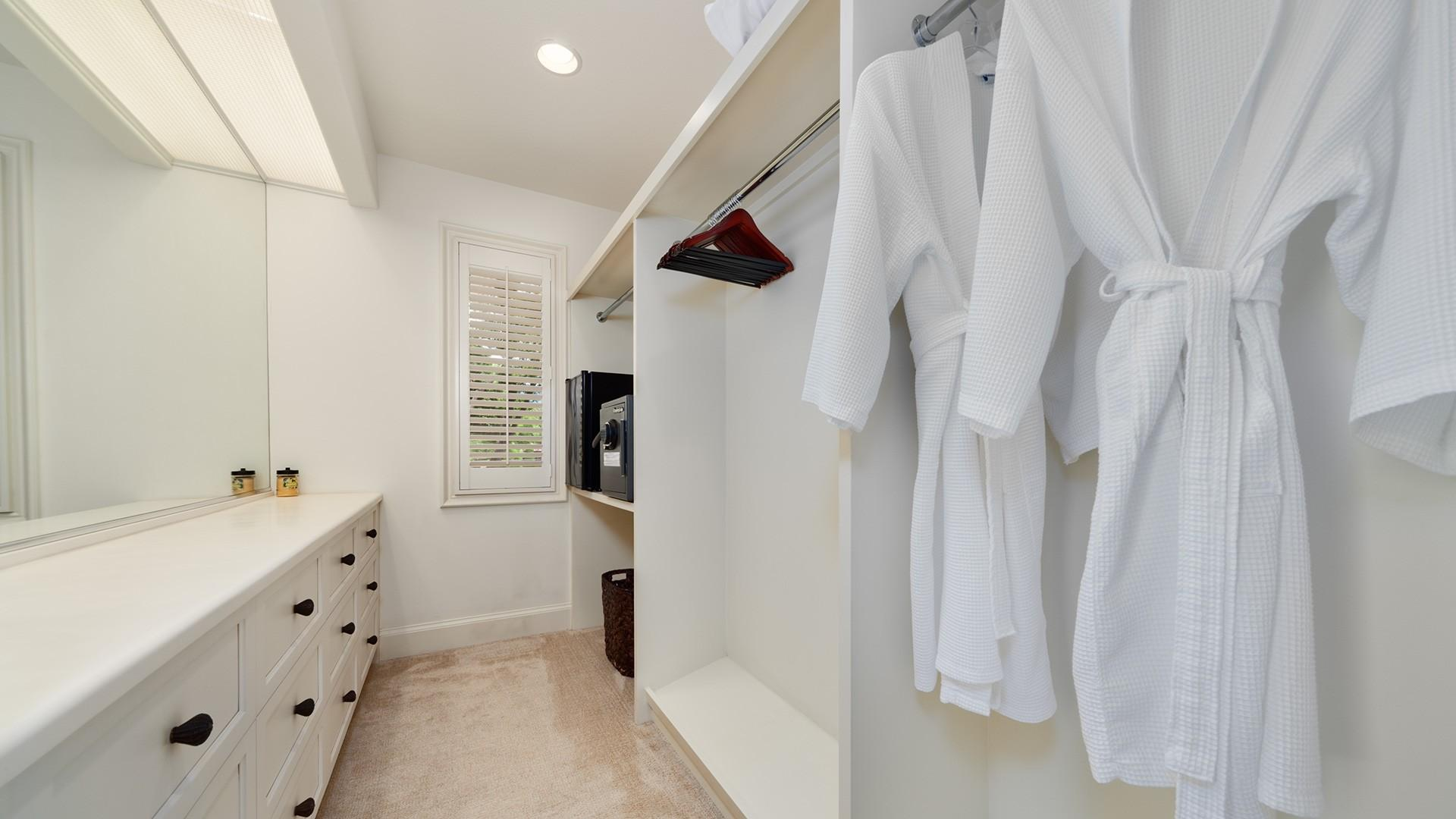 A safe is also provided in the roomy, well-equipped walk-in master bedroom closet.