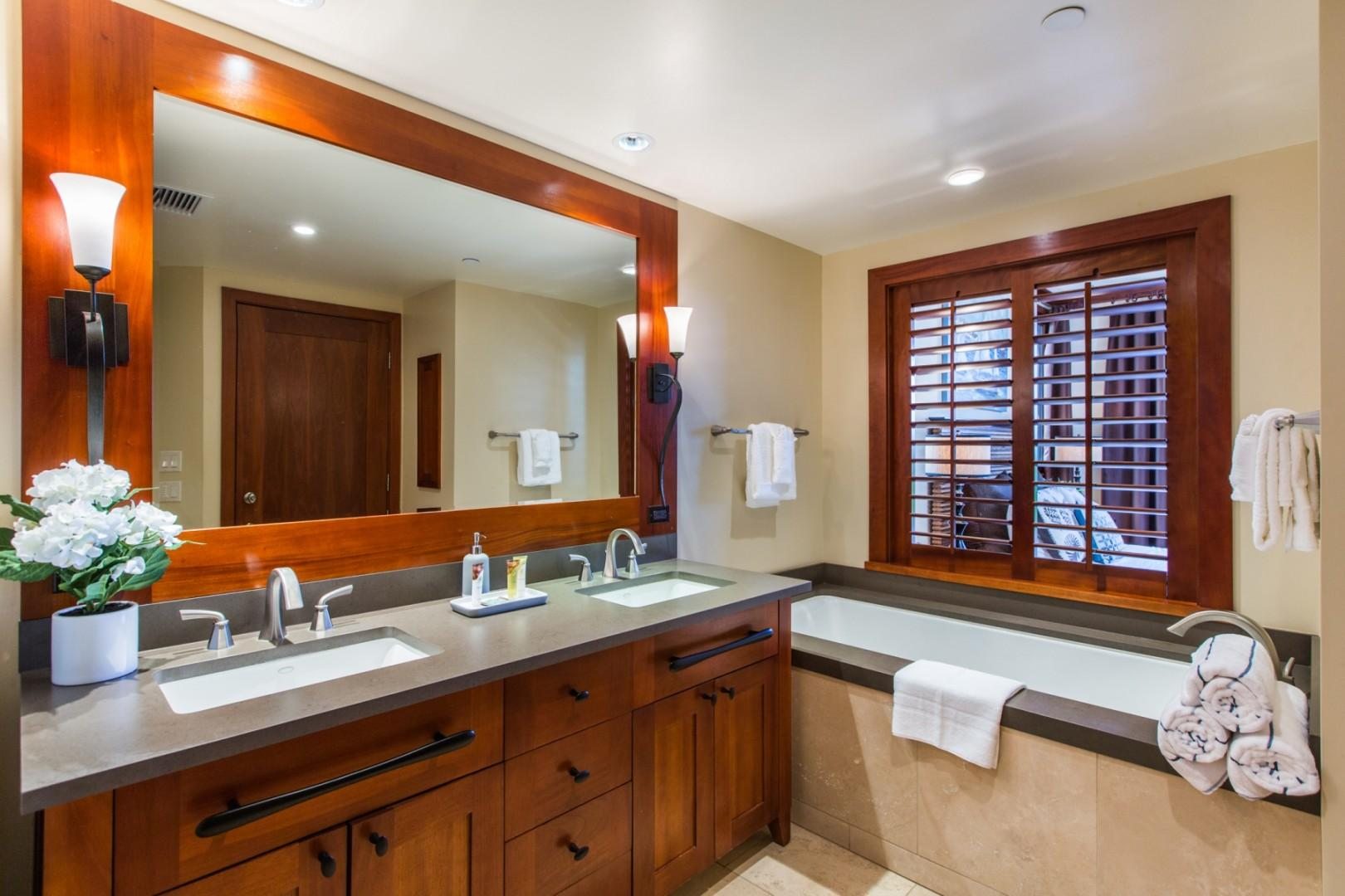 The master bathroom includes double sinks, deep soaking tub and separate shower