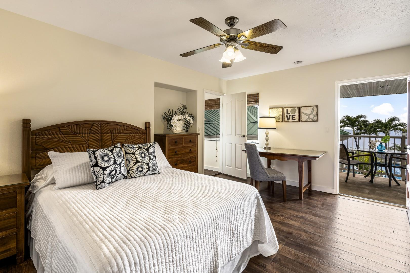 Guest bedroom featuring a Queen bed, A/C and Lanai access