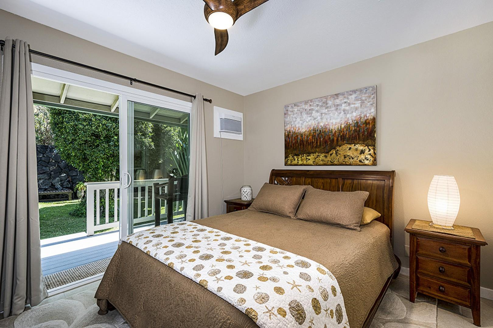 Cozy master bedroom with private ensuite, Queen bed, Lanai access, and A/C