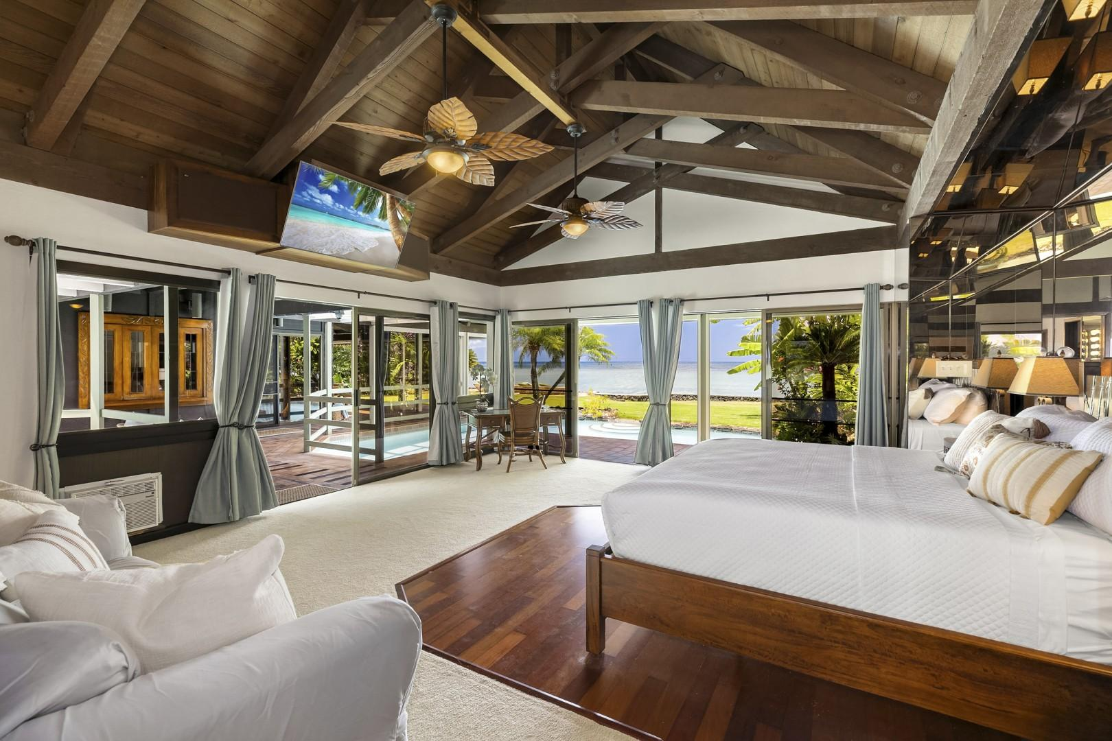 Master Suite has ensuite bathroom, vaulted ceilings, sofa, a/c, tv, desk and poolside lanai.