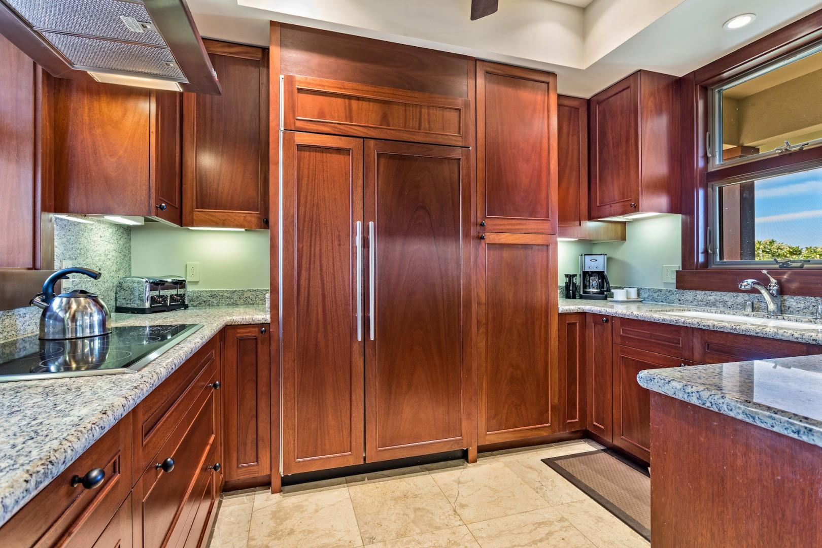 Elegant wood paneling and an ocean view from the kitchen sink.