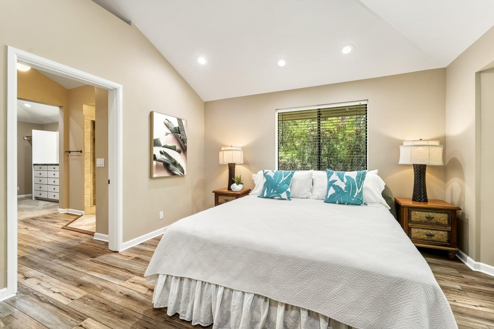 Large bedroom with views of the mature landscape is the perfect place to lay your head