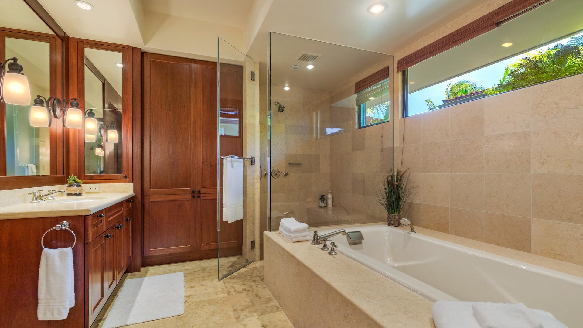 Separate walk-in shower and dual vanity in the master.