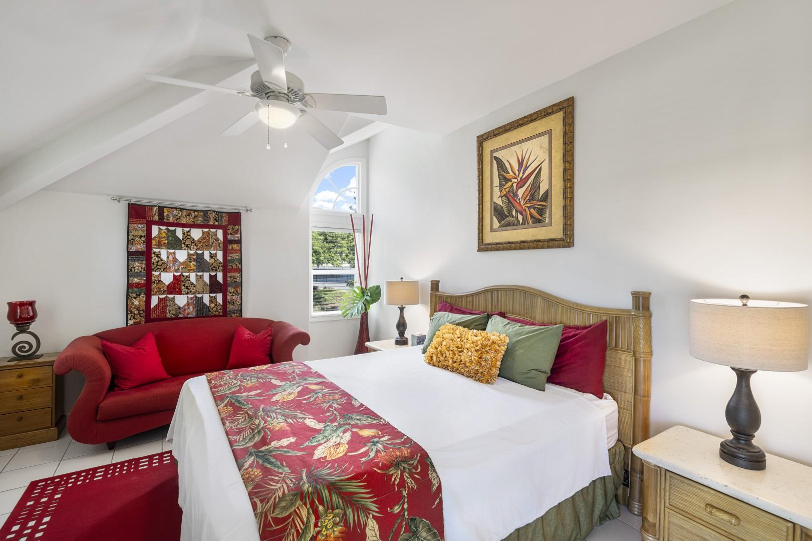 Red bedroom with Queen bed, A/C and private balcony