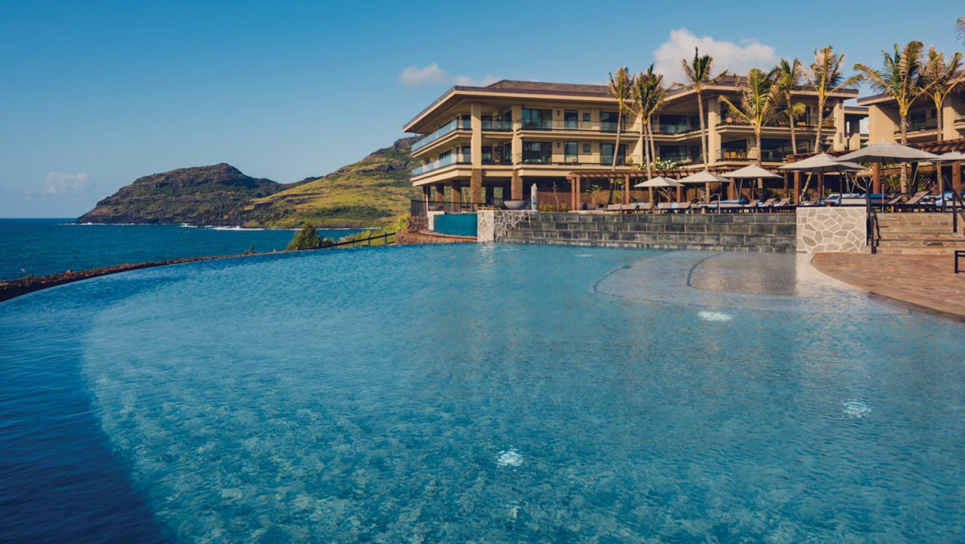 Spend your days oceanfront, in the two-tiered, infinity-edge pool.