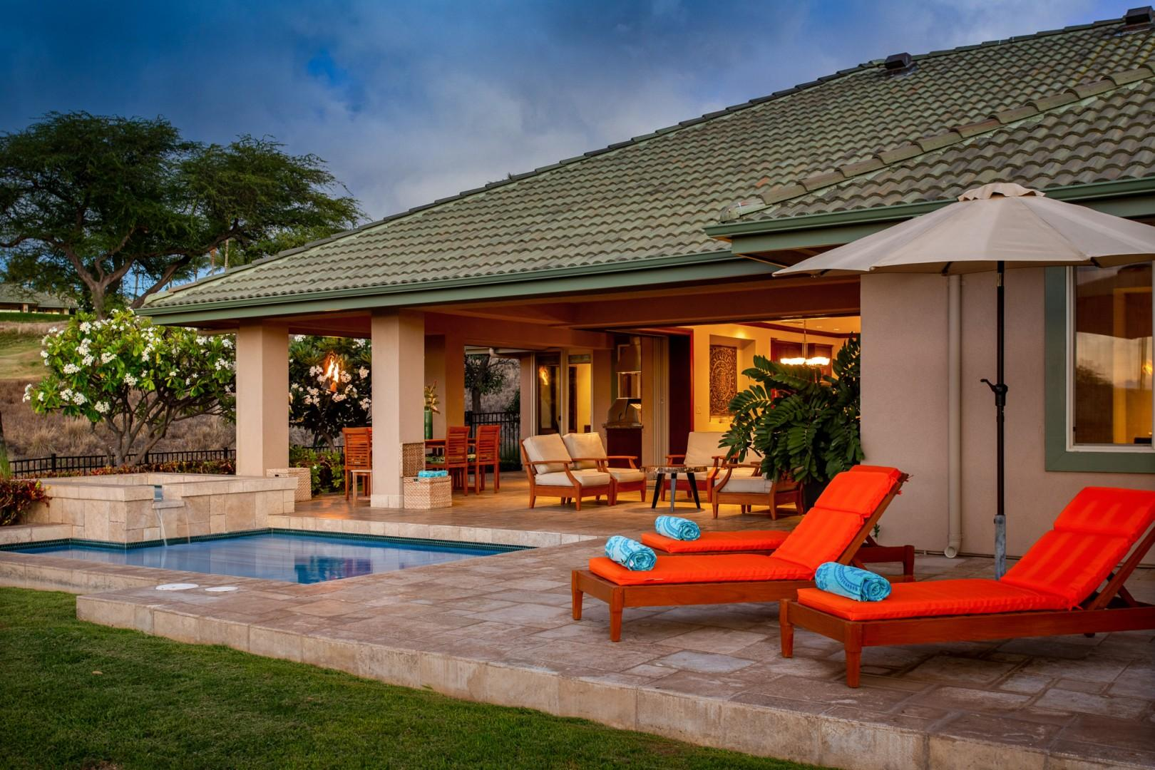 Alternate view of pool deck, lanai, and home's interior at sunset.