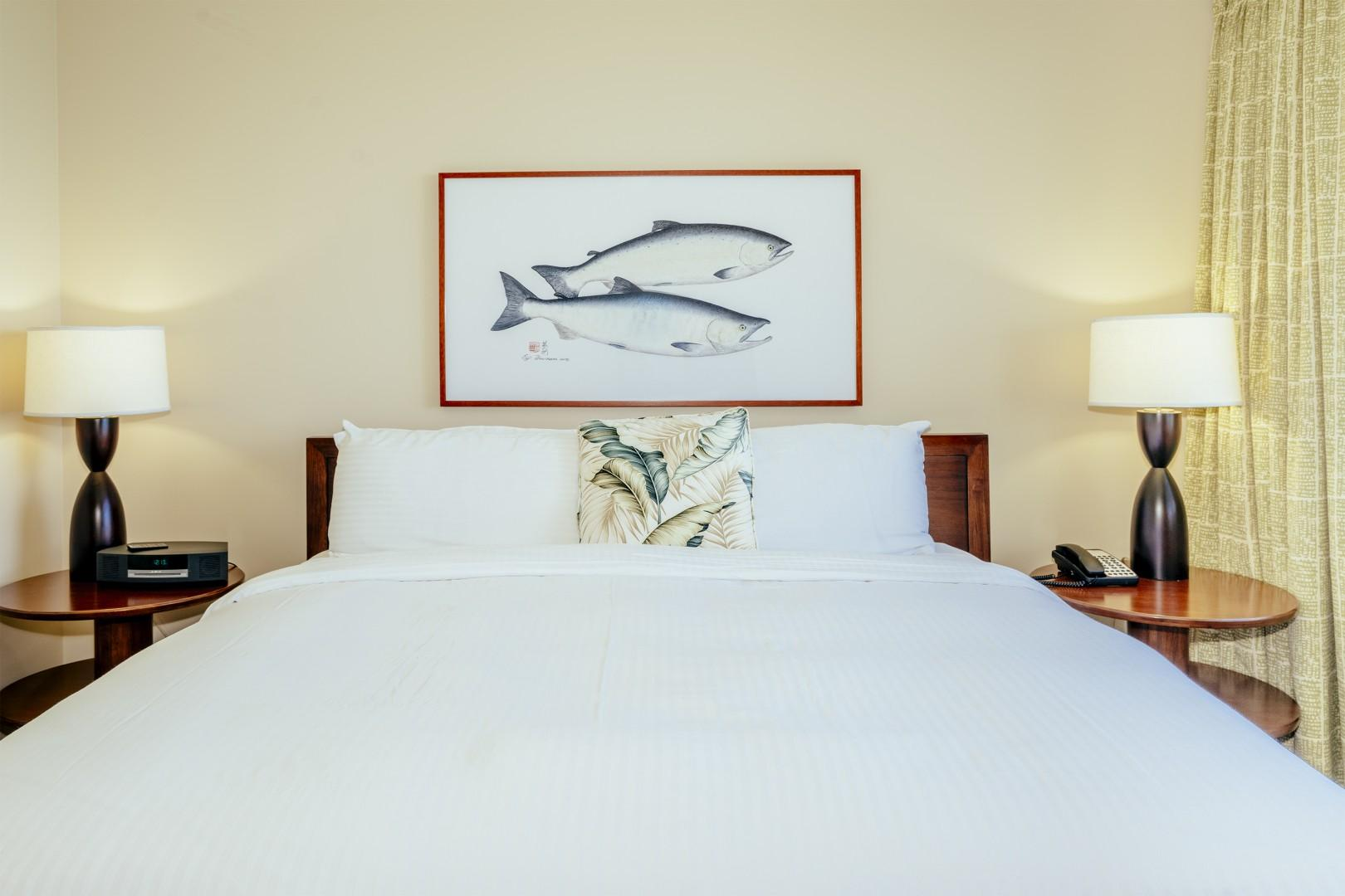 Comfy king size bed in the master bedroom that has a picture window facing the ocean.