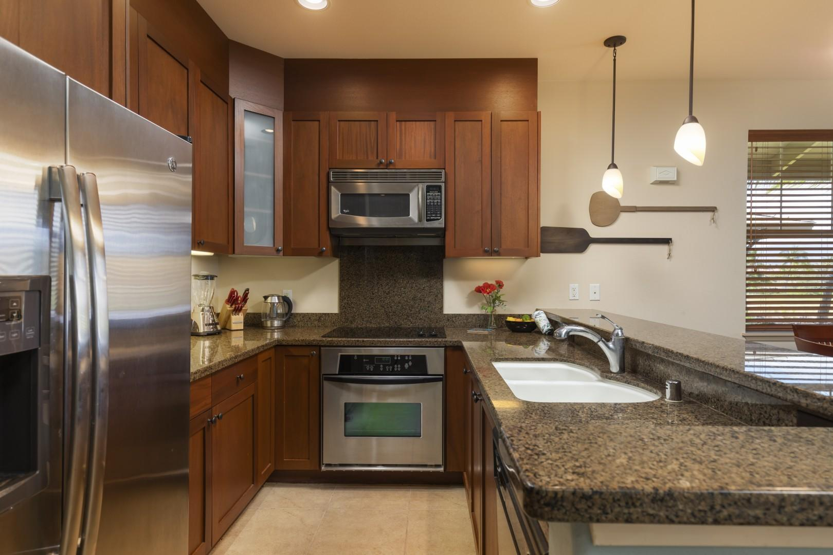 Your gormet kitchen with upscale appliances is the perfect spot to prepare meals during your stay.