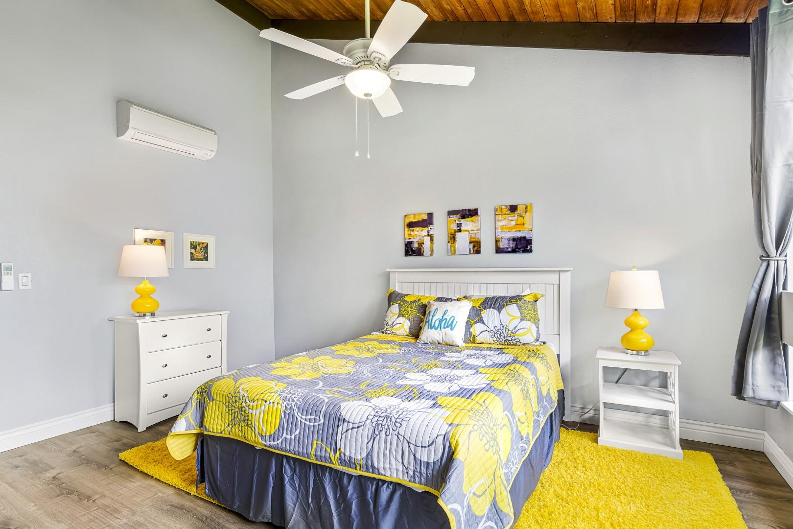 The bedroom is a reminder of the state flower, the Yellow Hibiscus