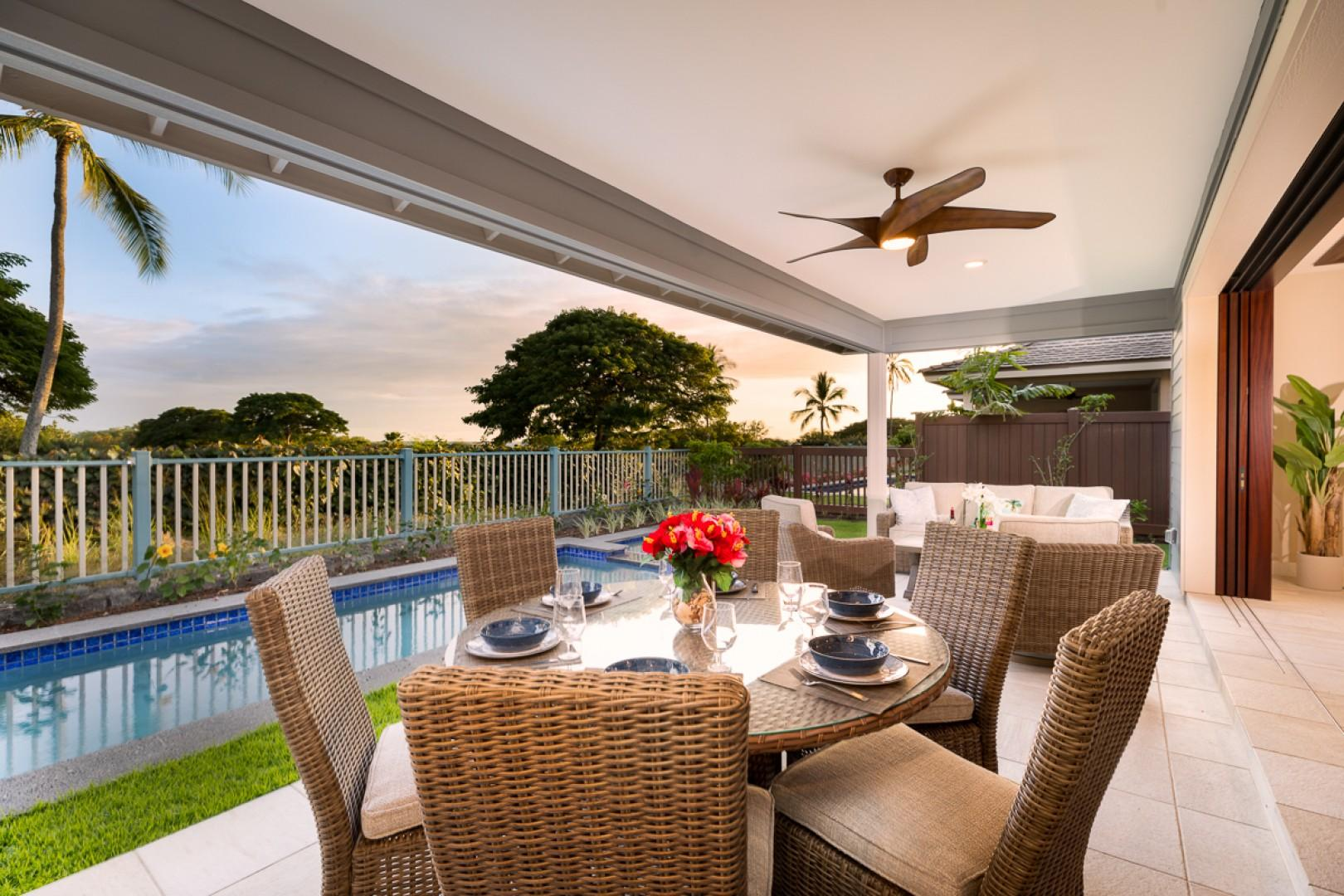 Enjoy open-air meals poolside on the covered lanai