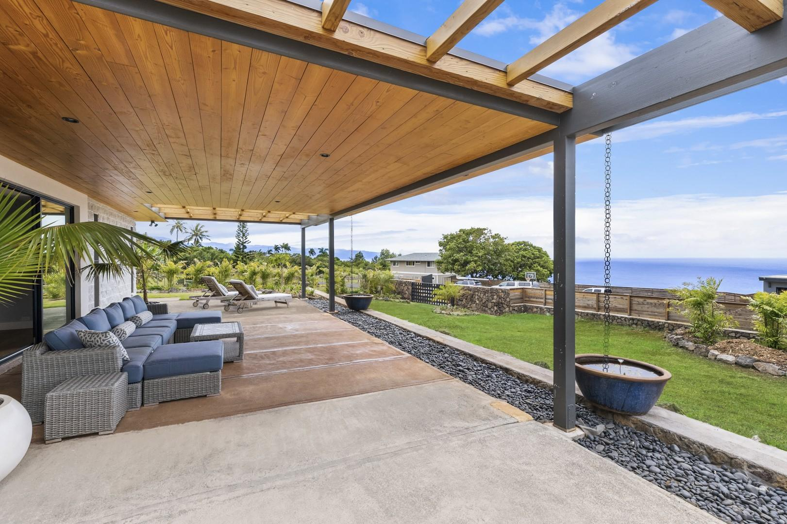 Front lanai with comfortable lounge chairs