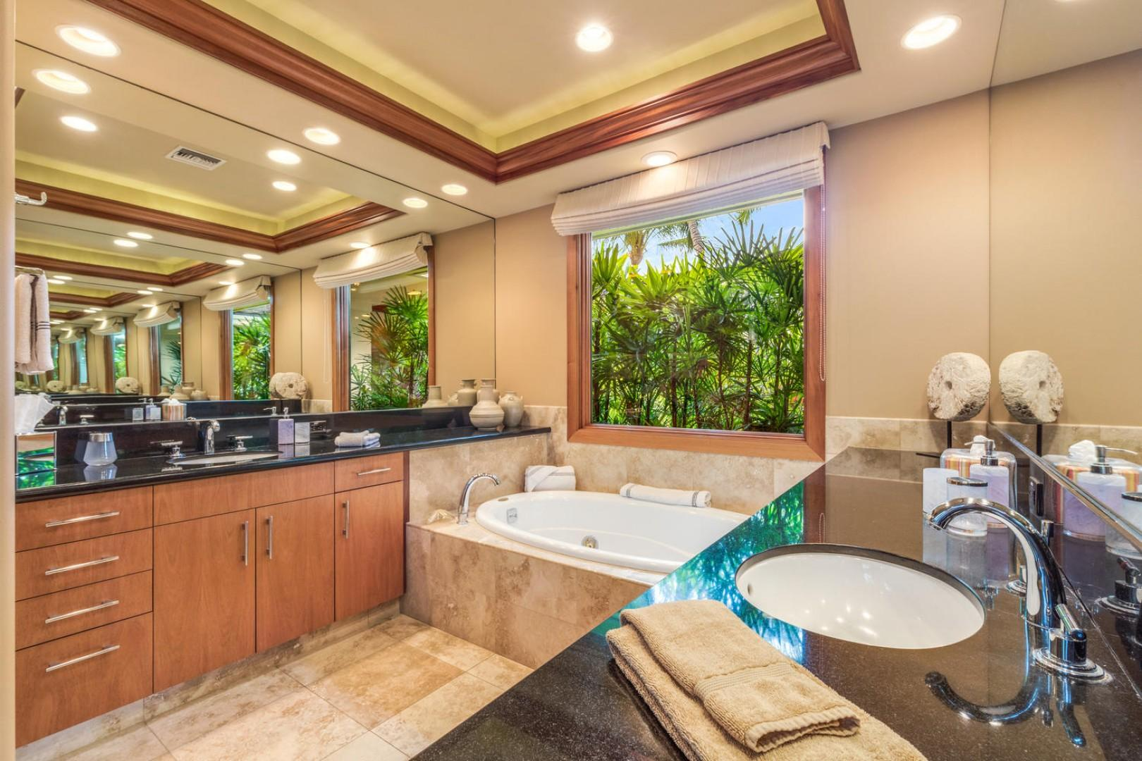 Opulent master bath with dual vanity, jetted tub, and walk-in shower.